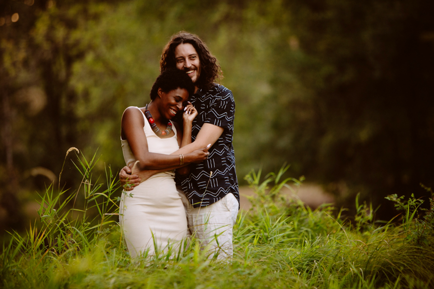 Happy engagement portrait in grass field - photo by Jessica Hill Photography, Portland