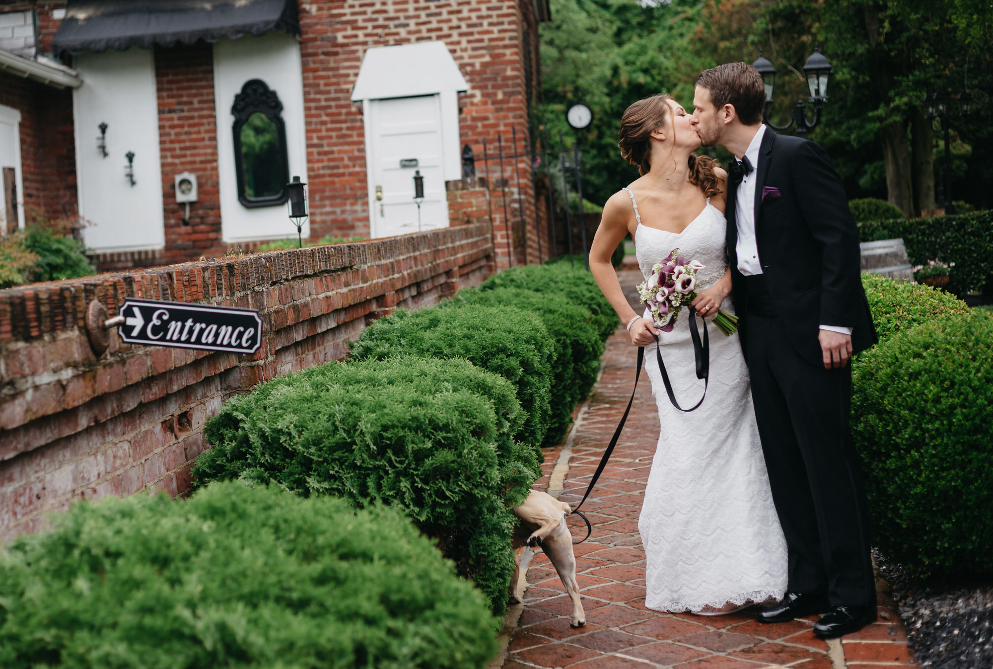 Couple kissing while dog pees - photo by Ken Pak Photography