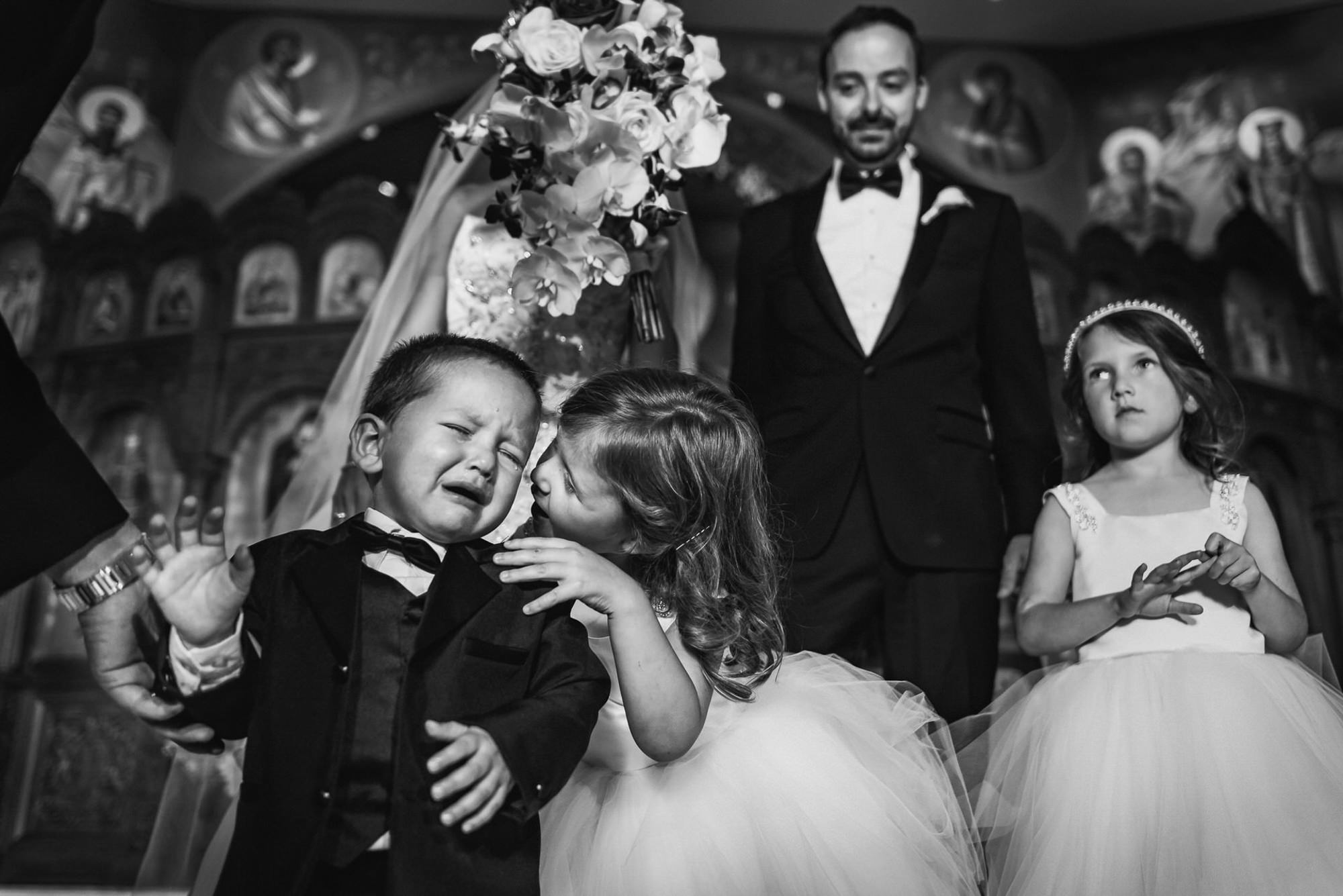 Kids comforting each other at ceremony - photo by Ken Pak Photography