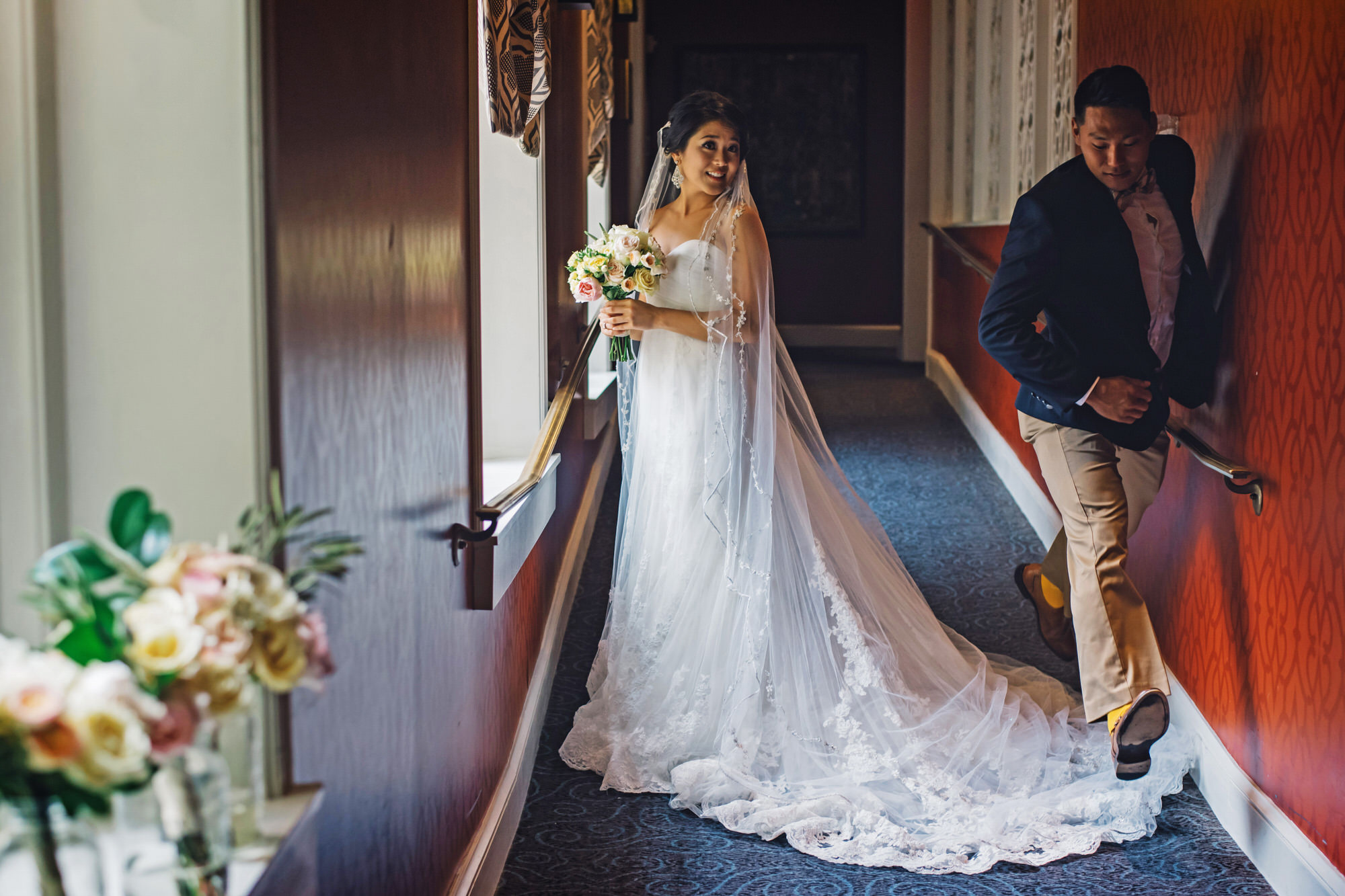 Man stepping over bridal train - photo by Ken Pak Photography