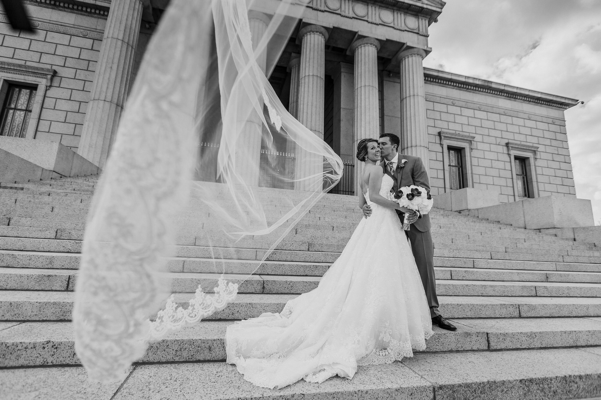 Veil flying away during bridal portraits - photo by Ken Pak Photography