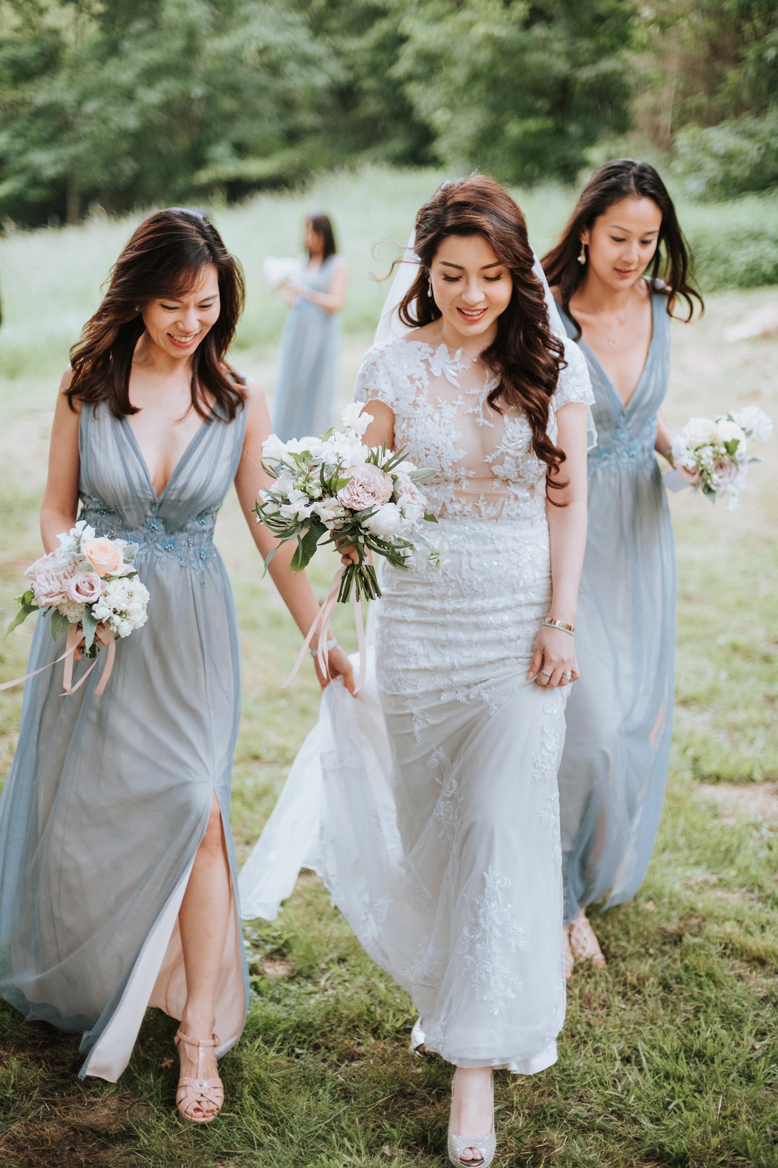Bride walking with bridesmaids- photo by Mun Keat Studio
