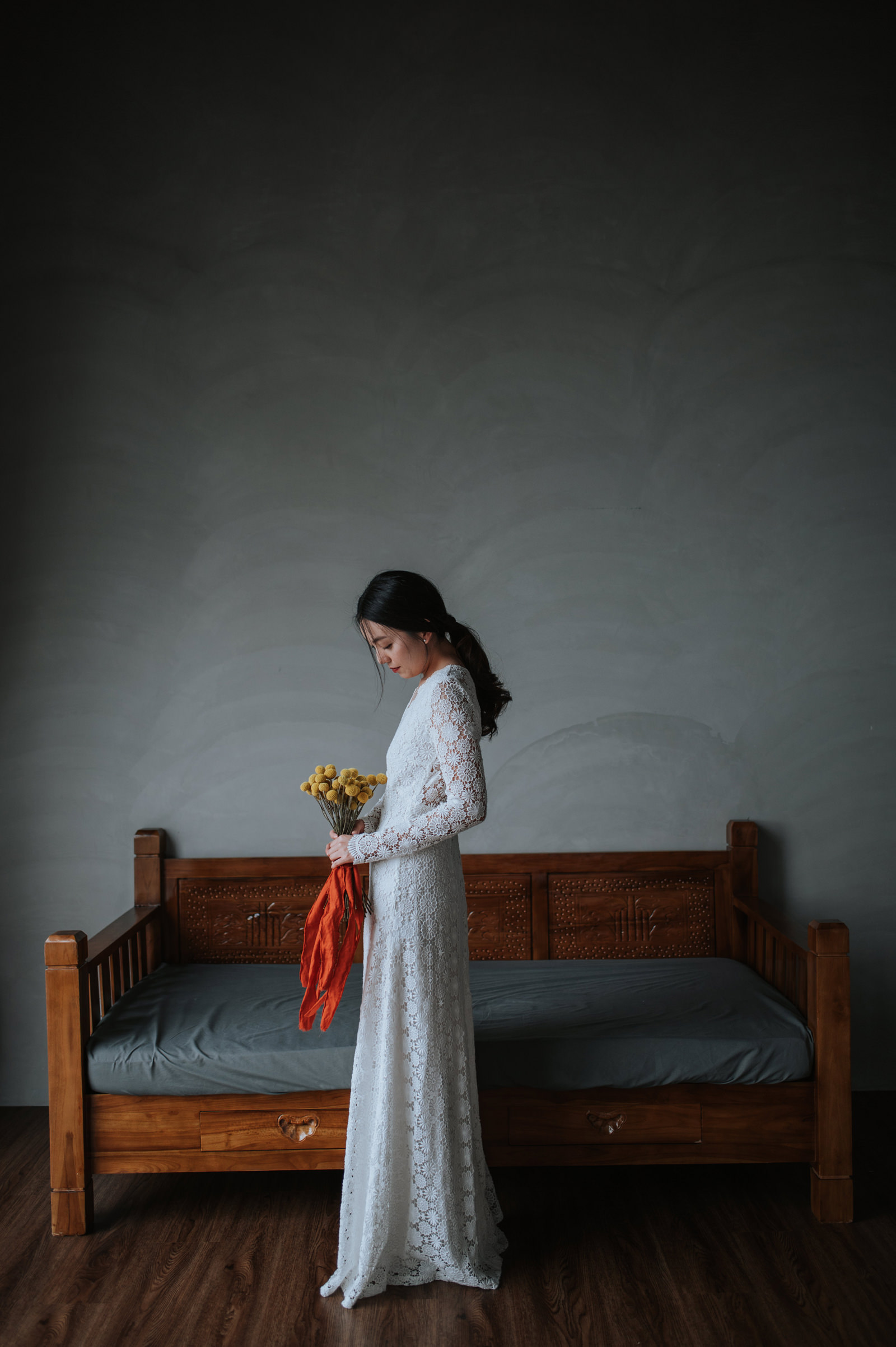 Elegant bride portrait against day bed - photo by Mun Keat Studio