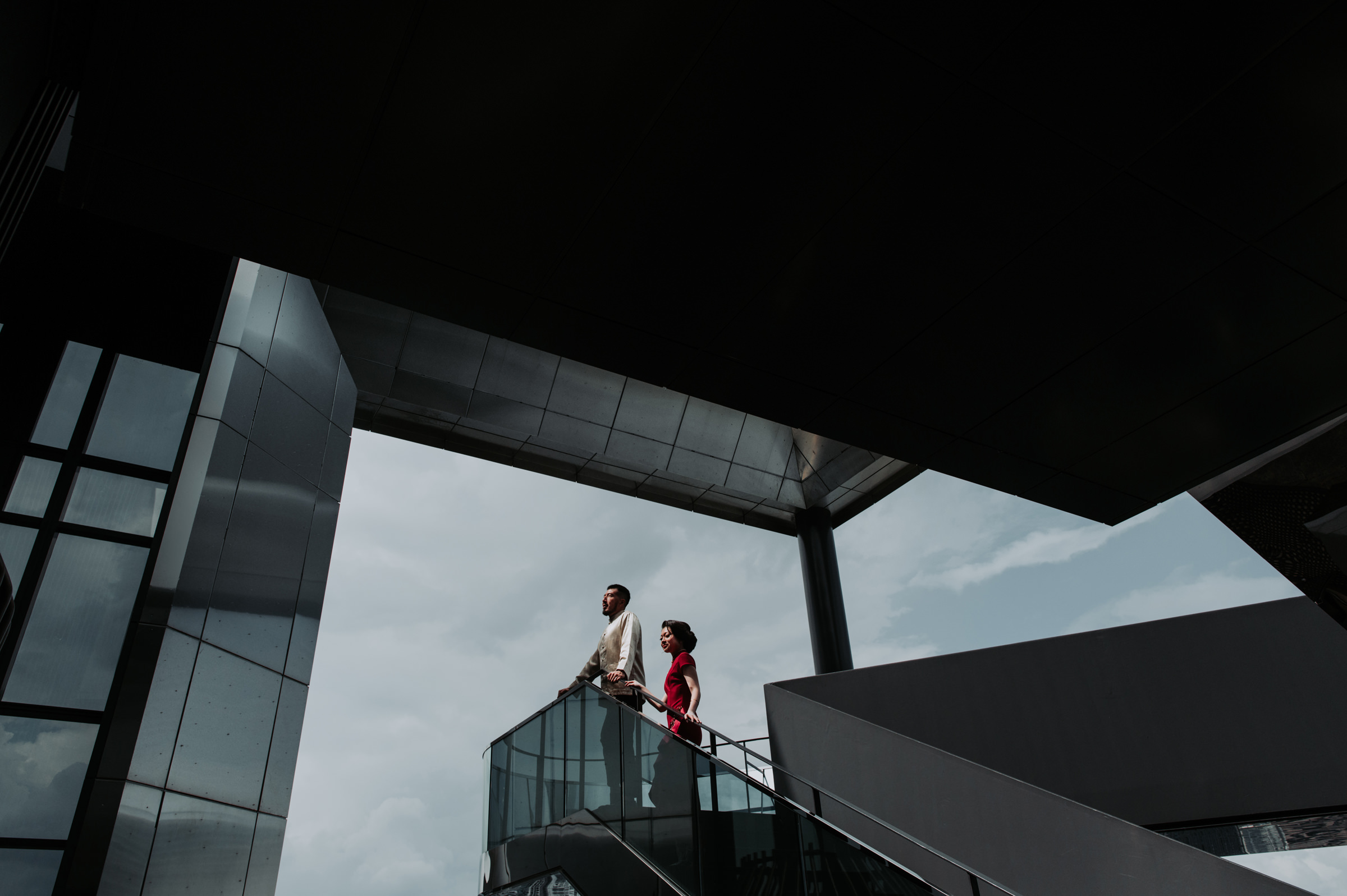 Engagement couple in architectural setting - photo by Mun Keat Studio