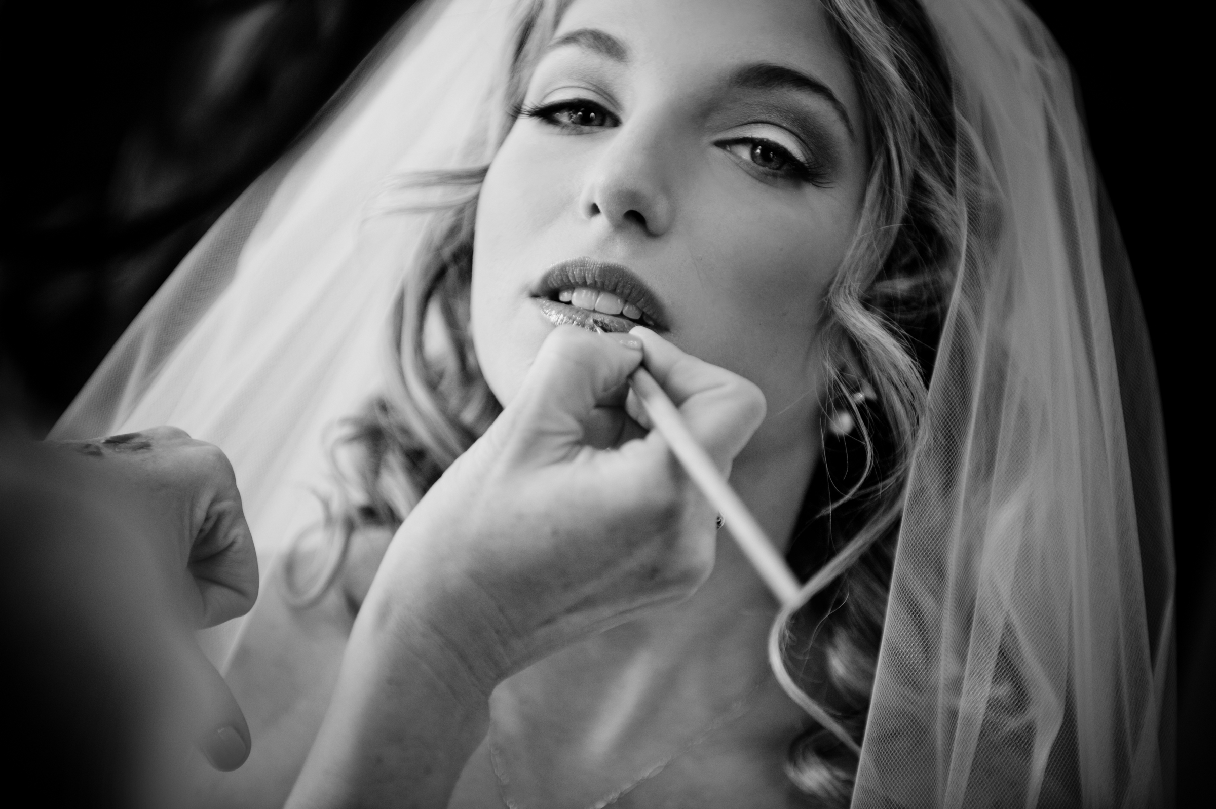 Bride having makeup applied - photo by Morgan Lynn Photography