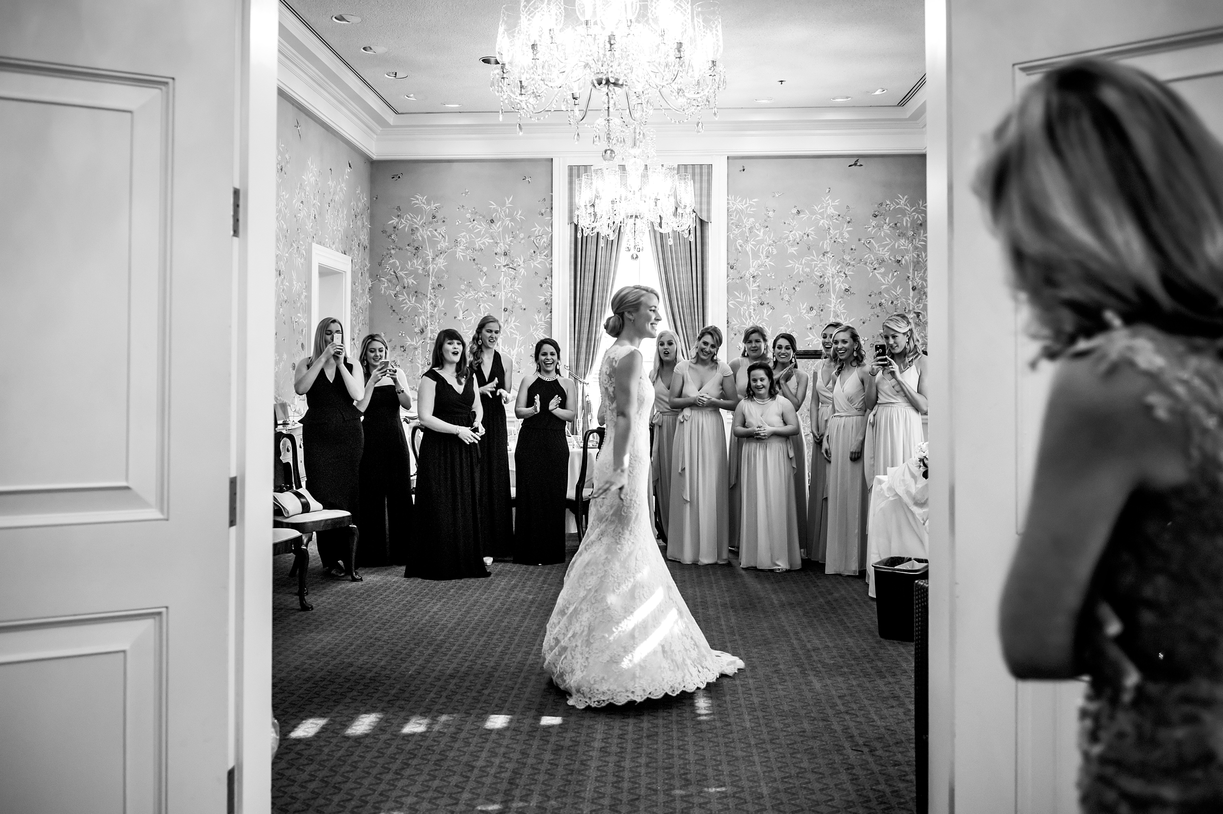Bride showing off gown - photo by Morgan Lynn Photography