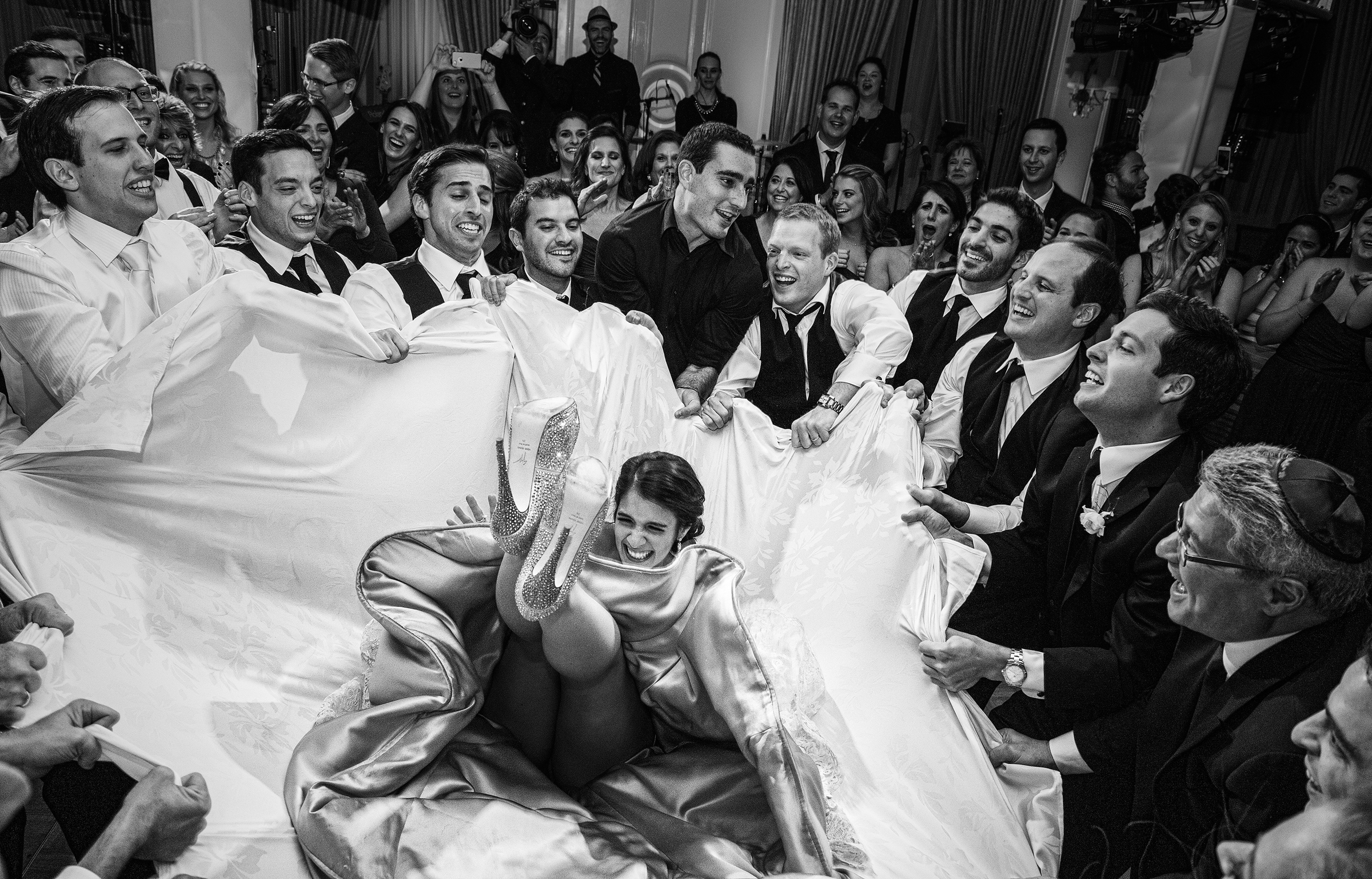 Celebrants-tossing the bride - photo by Morgan Lynn Photography