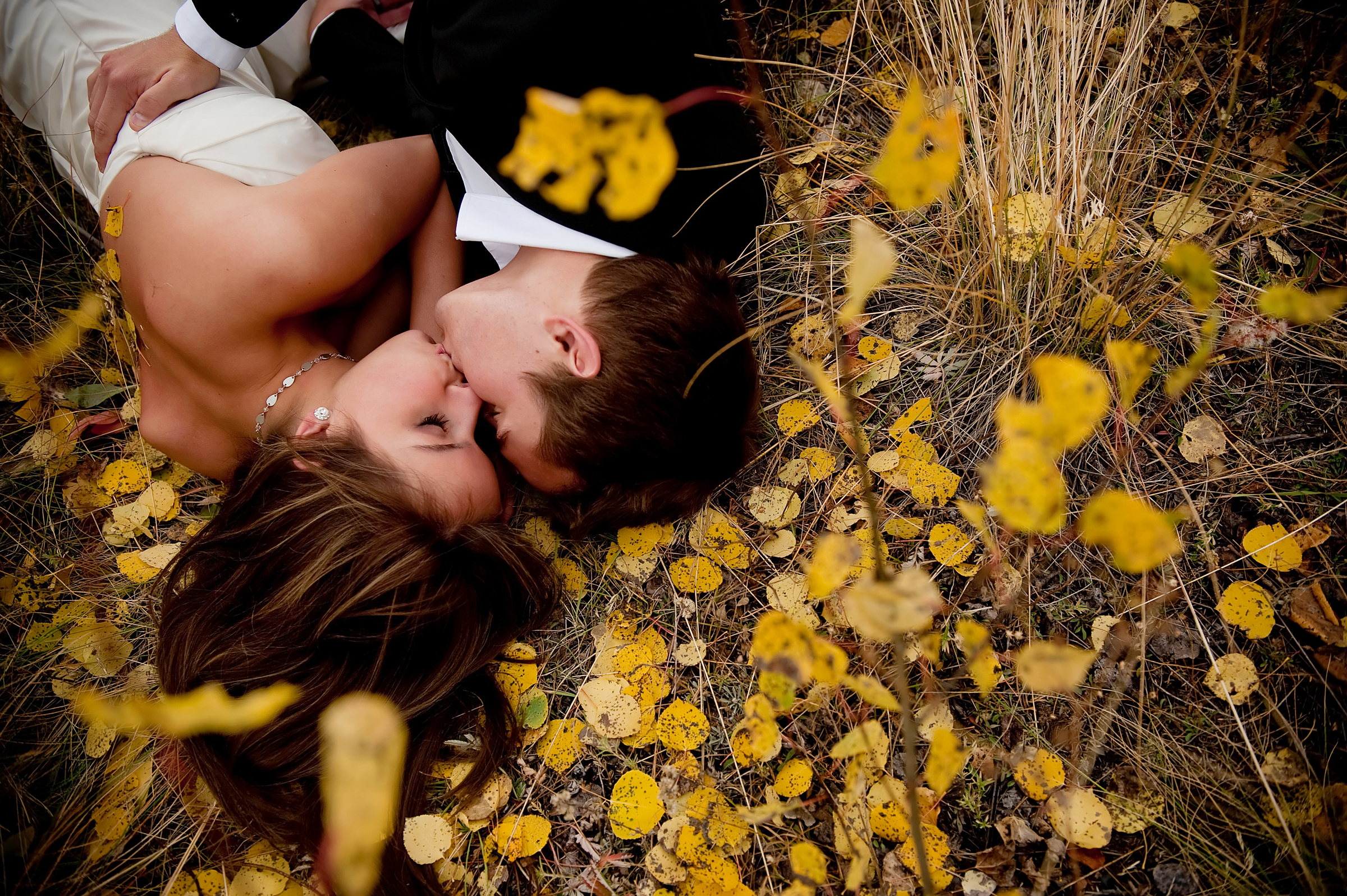 Couple against autumn leaves - photo by Morgan Lynn Photography