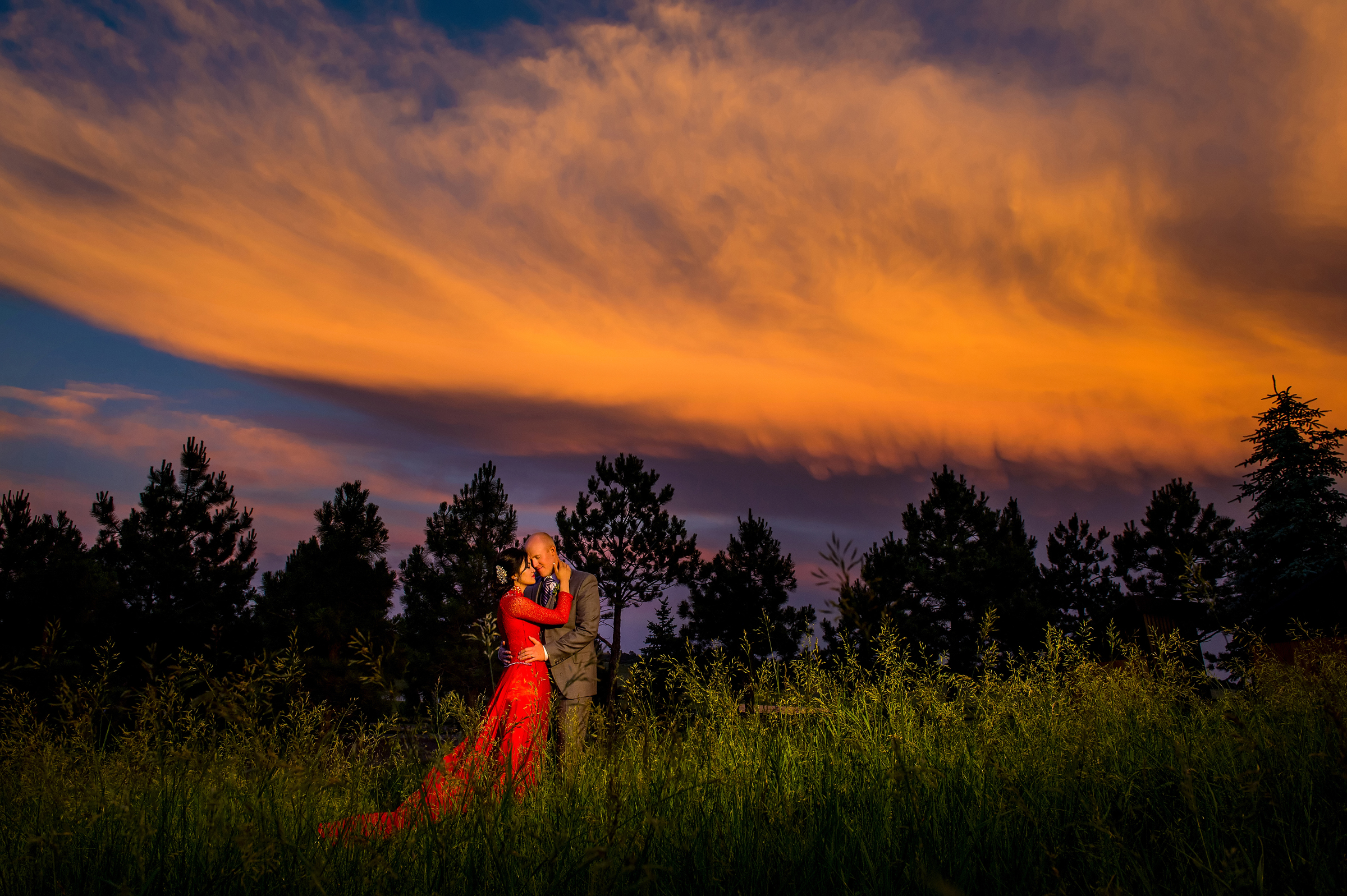 Couple against dramatic skies - photo by Morgan Lynn Photography
