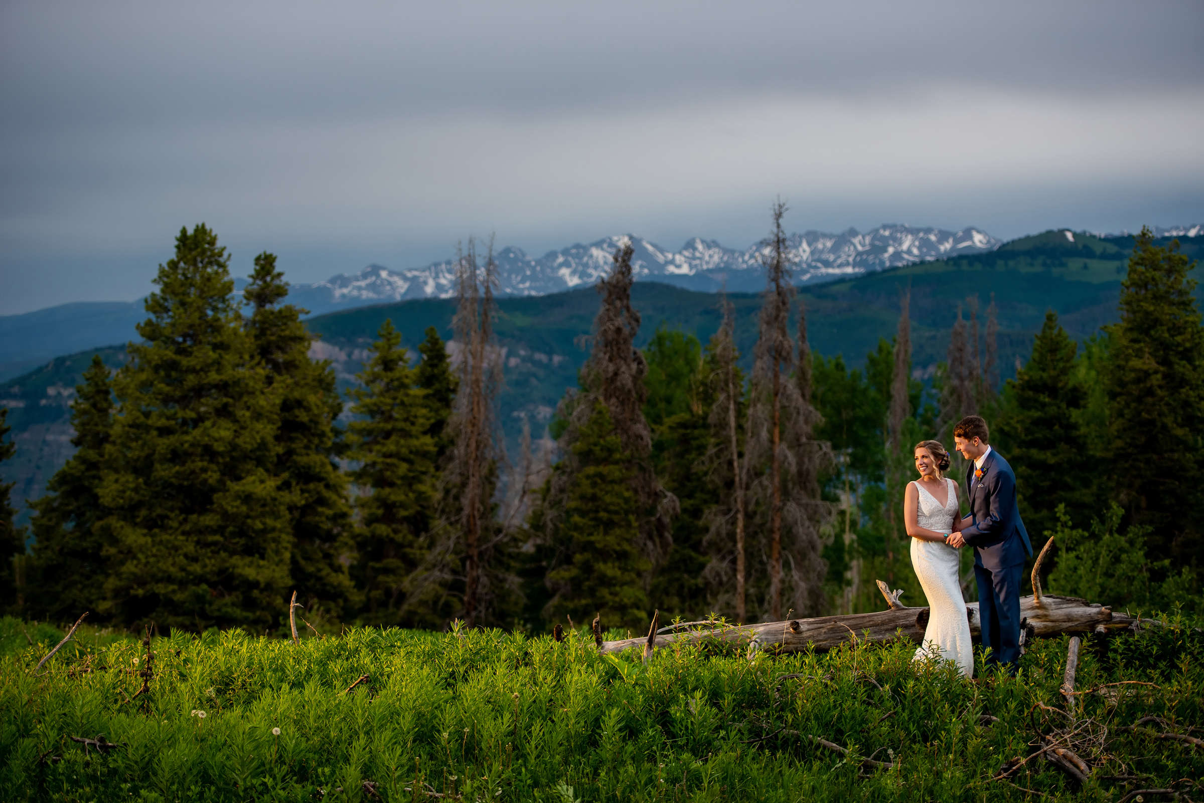 Couple against mountain backdrop - photo by Morgan Lynn Photography