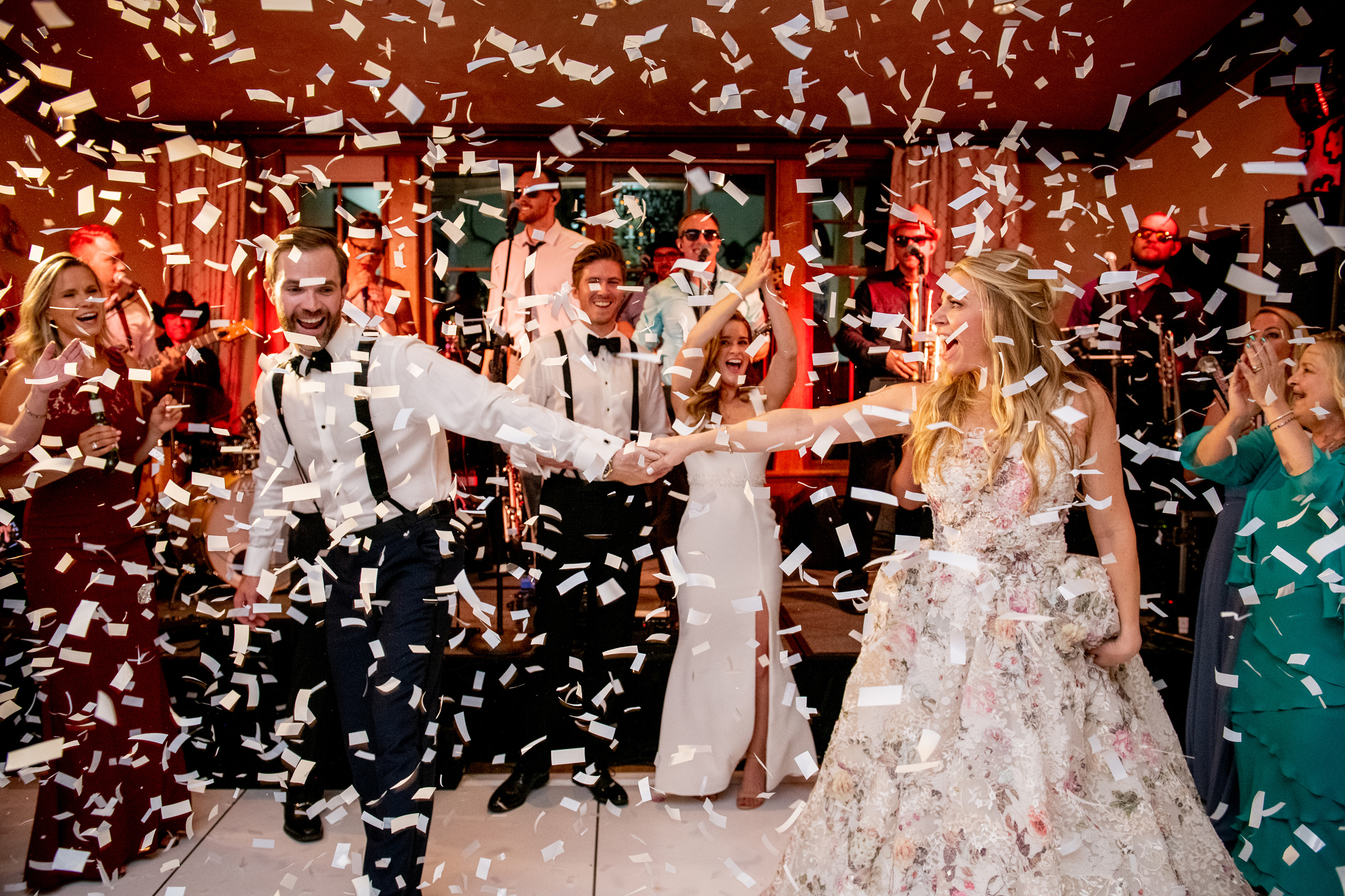 Couple dancing amid confetti - photo by Morgan Lynn Photography