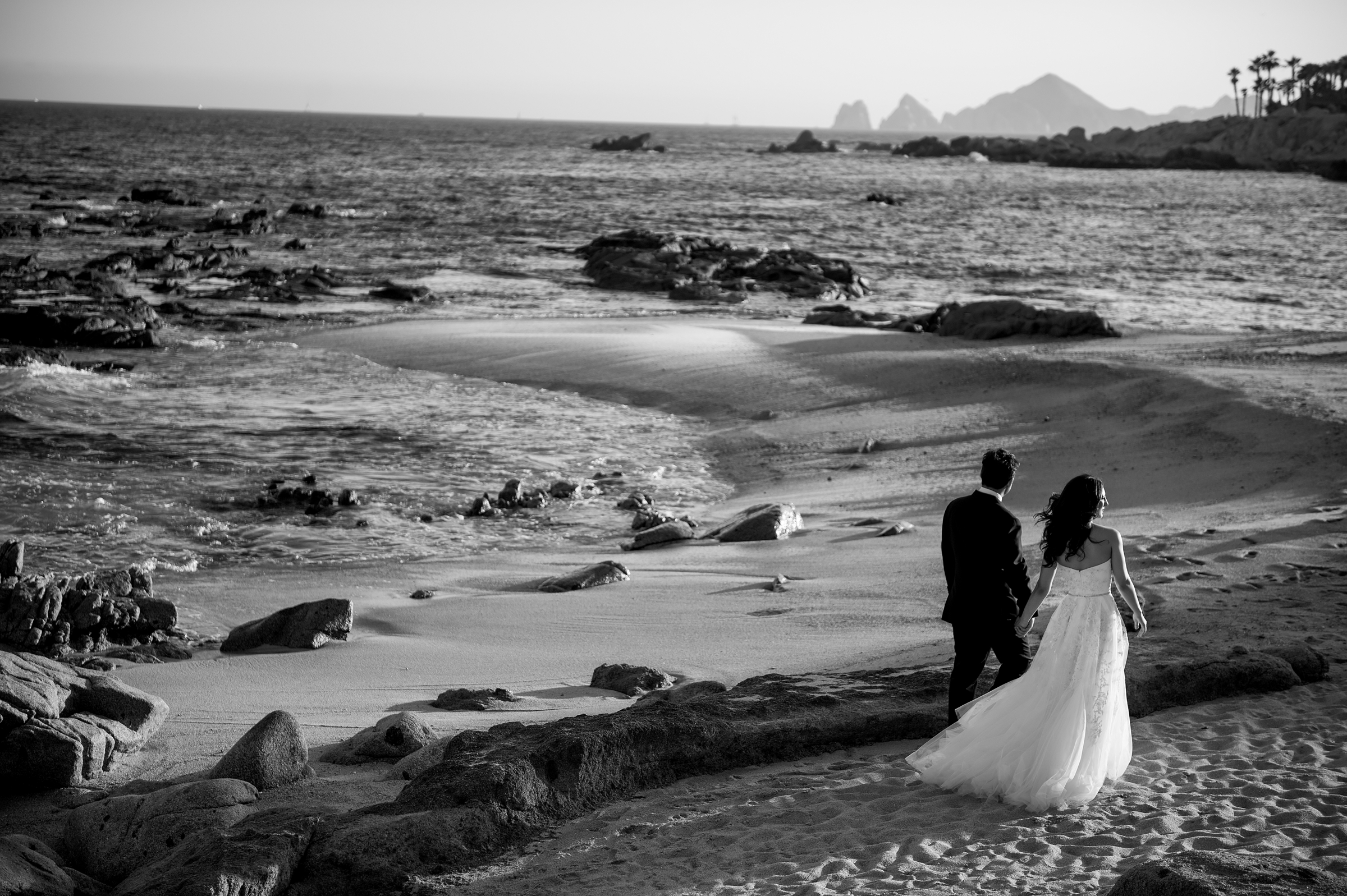 Couple walks on beach - photo by Morgan Lynn Photography