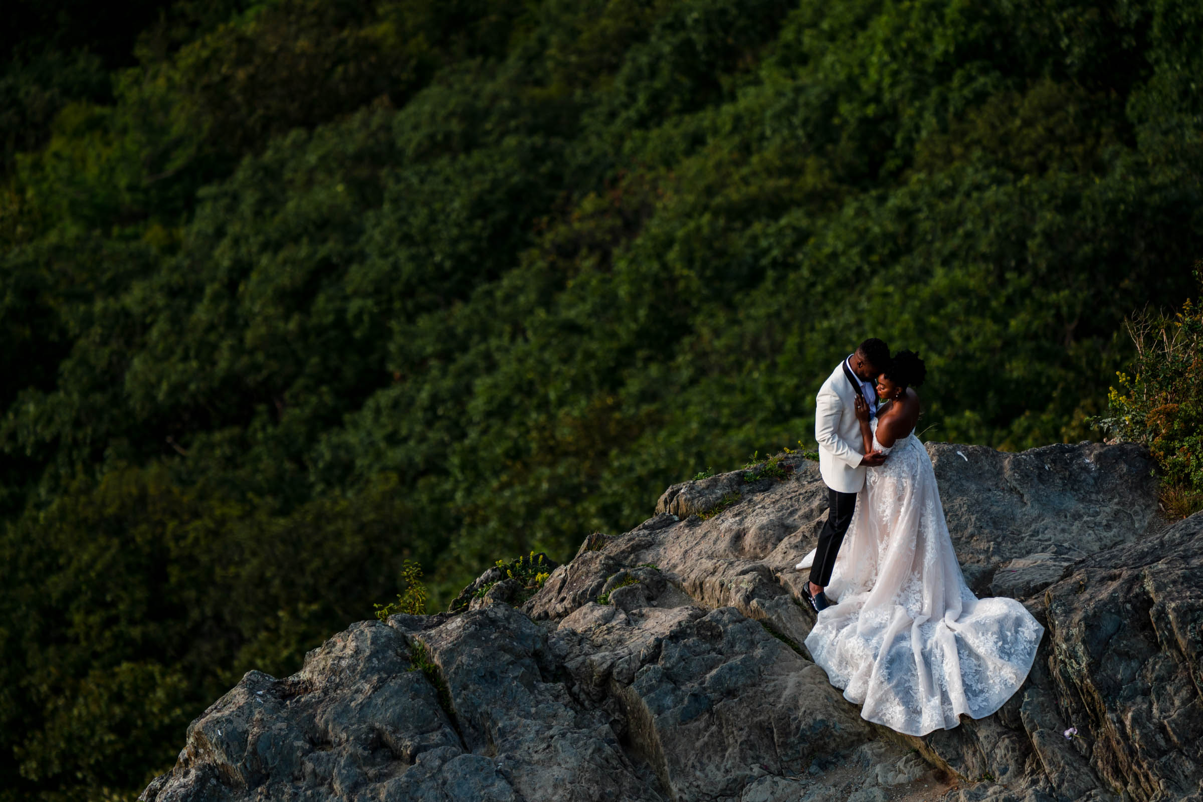 Drone view of couple embrace on Shenandoah cliffs- photo by Bee Two Sweet