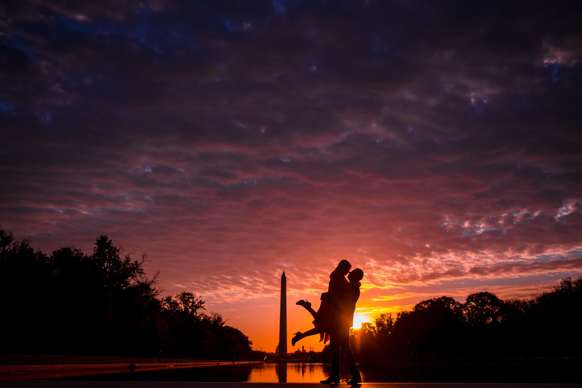Sunrise engagement photo against pools and Lincoln Memorial Washington DC - photo by Bee Two Sweet