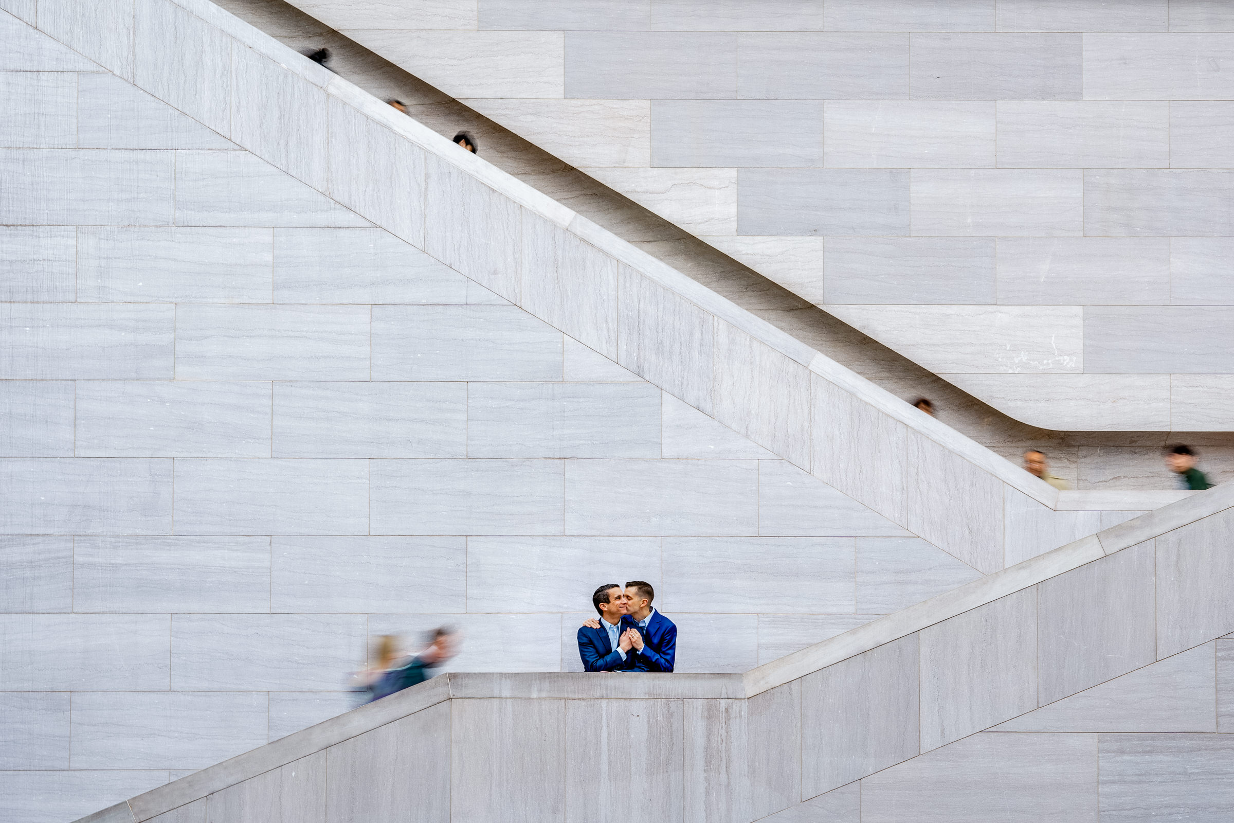 Couple embracing on stairs - photo by Bee Two Sweet