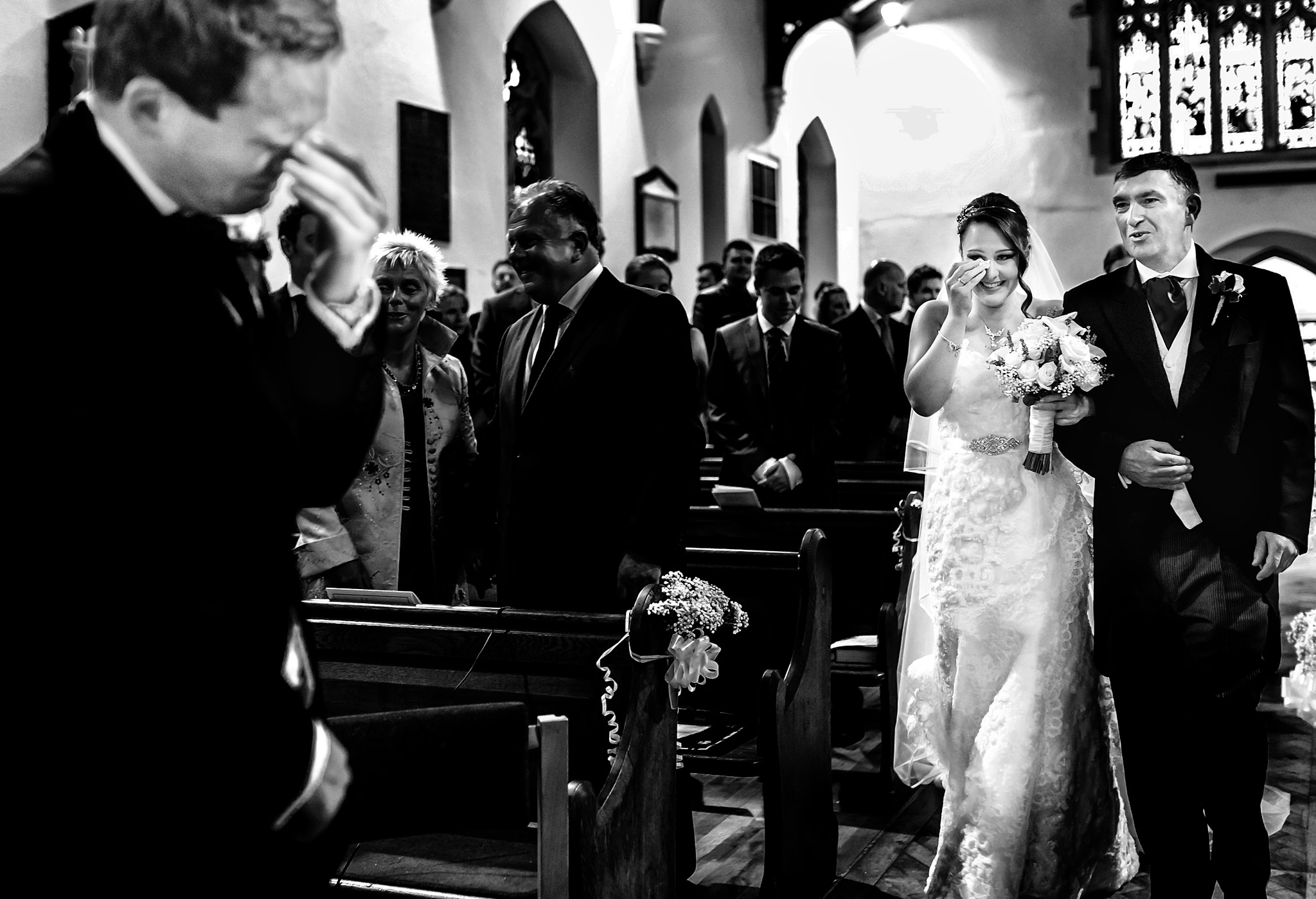 Bride comes down aisle to crying groom - photo by Rich Howman