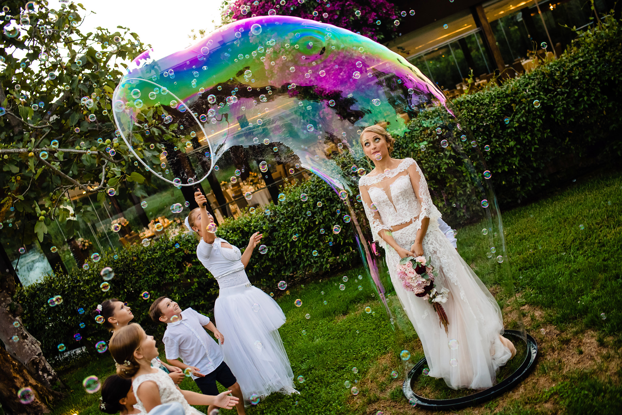 Bride surrounded by rainbow bubble - photo by Rich Howman