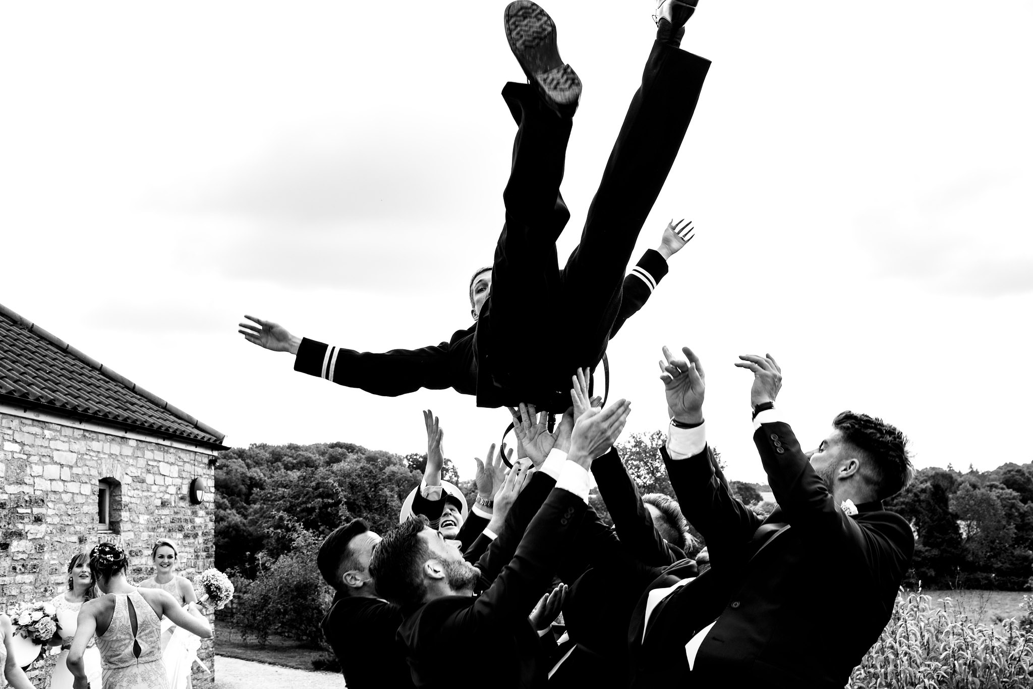 Groom thrown in the air by military brothers - photo by Rich Howman