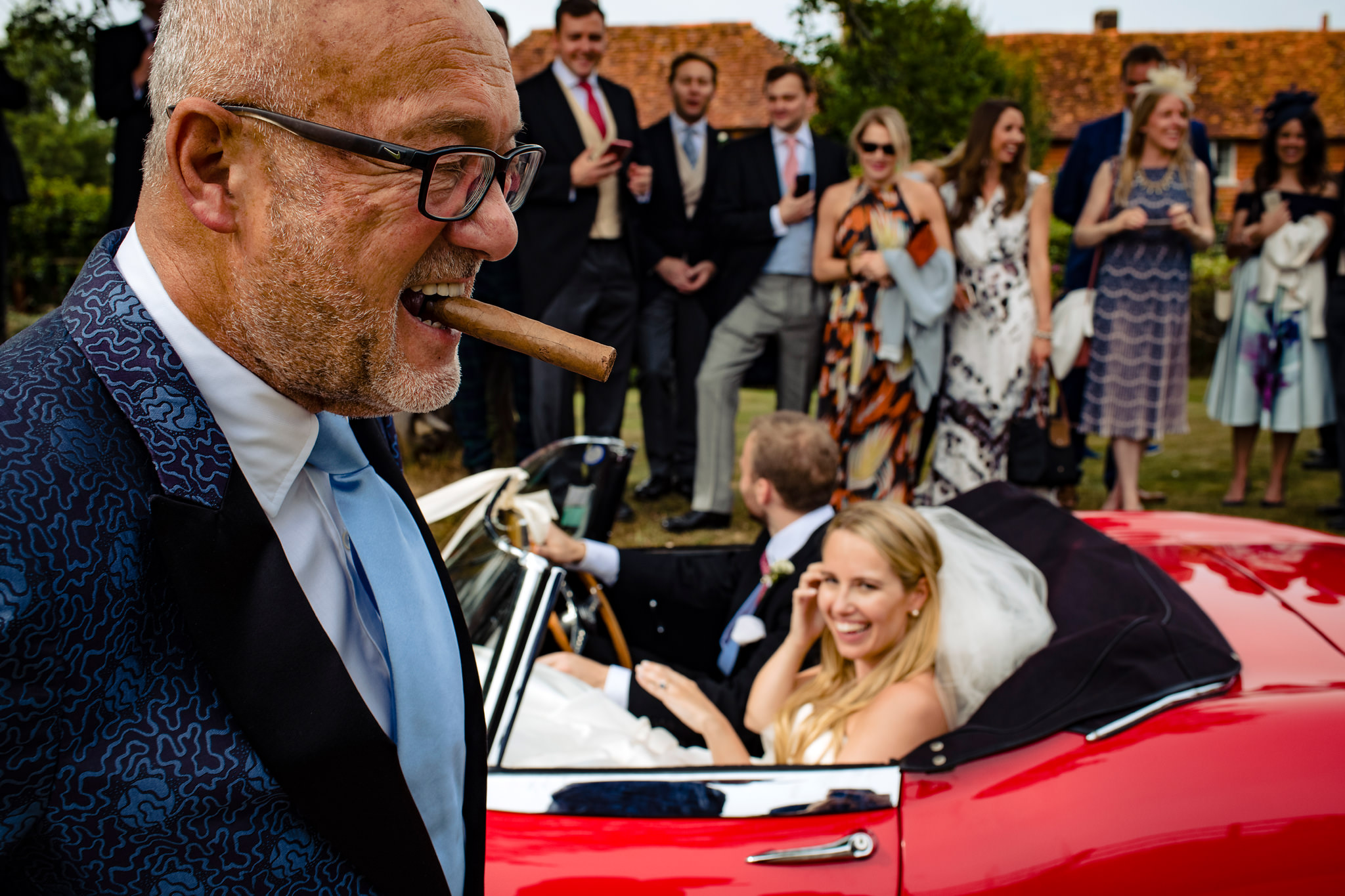 Man with cigar makes bride laugh - photo by Rich Howman