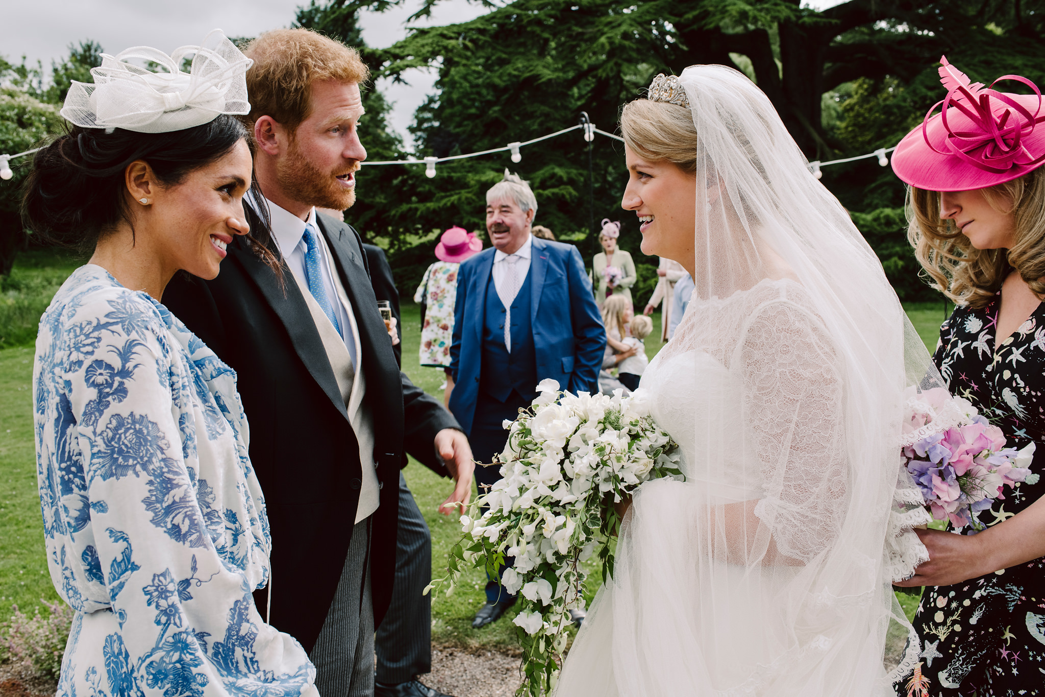 Prince Harry and Duchess of Sussex Meghan Markle greet bride - photo by Rich Howman