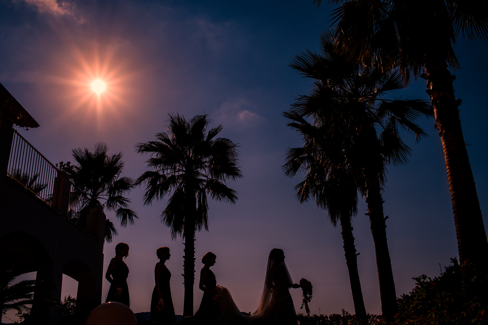 Tropical silhouette of bride and bridesmaids - photo by Rich Howman