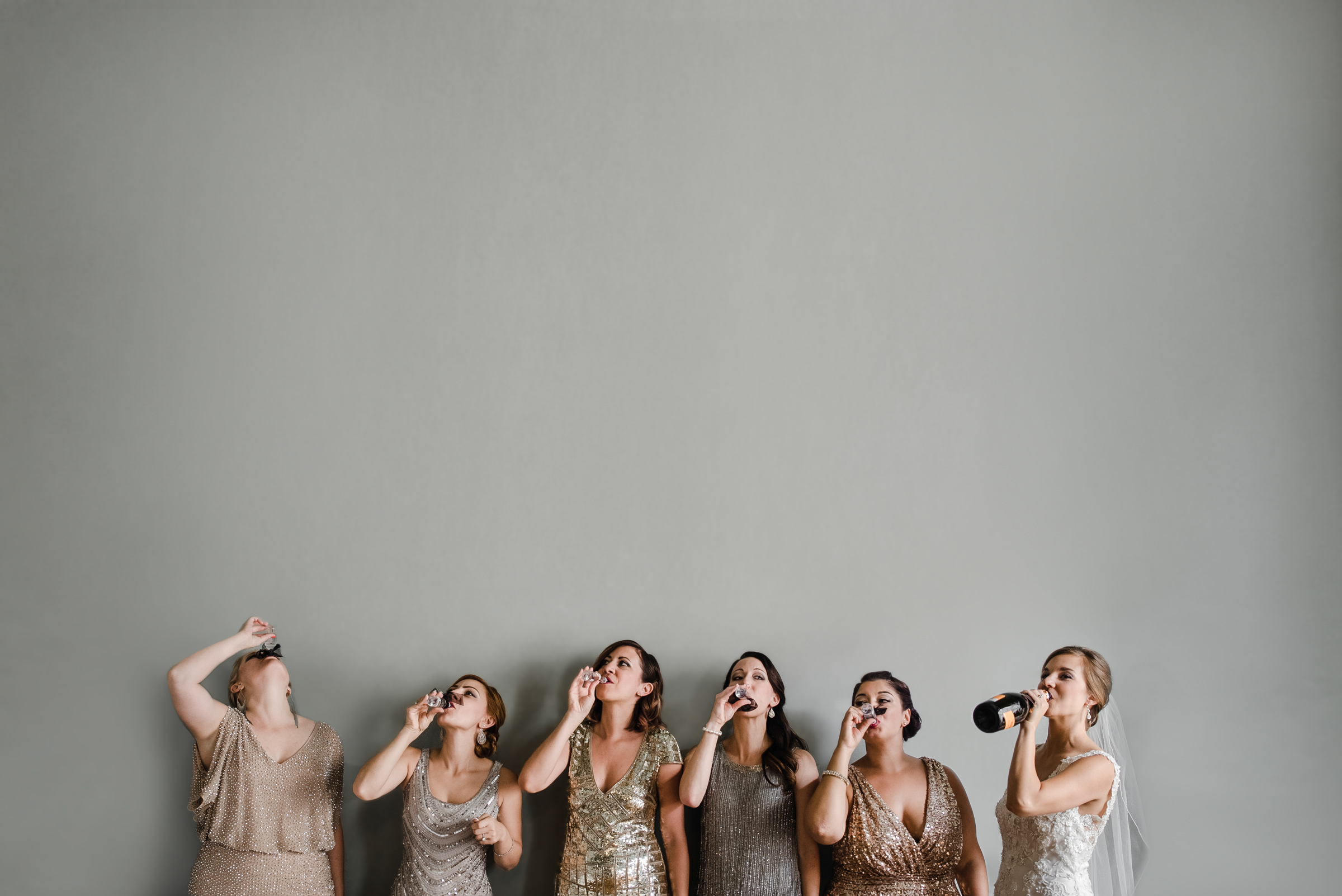 Bride and  bridesmaids with bottles - photo by Sasha Reiko Photography