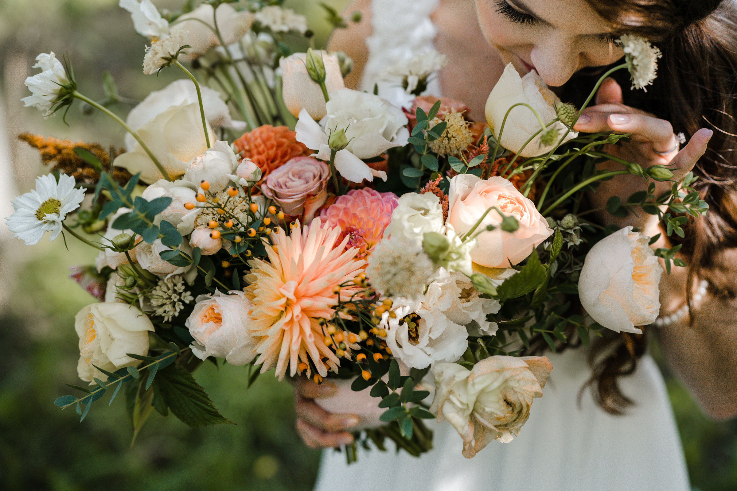 Bride with detail of bouquet - photo by Sasha Reiko Photography
