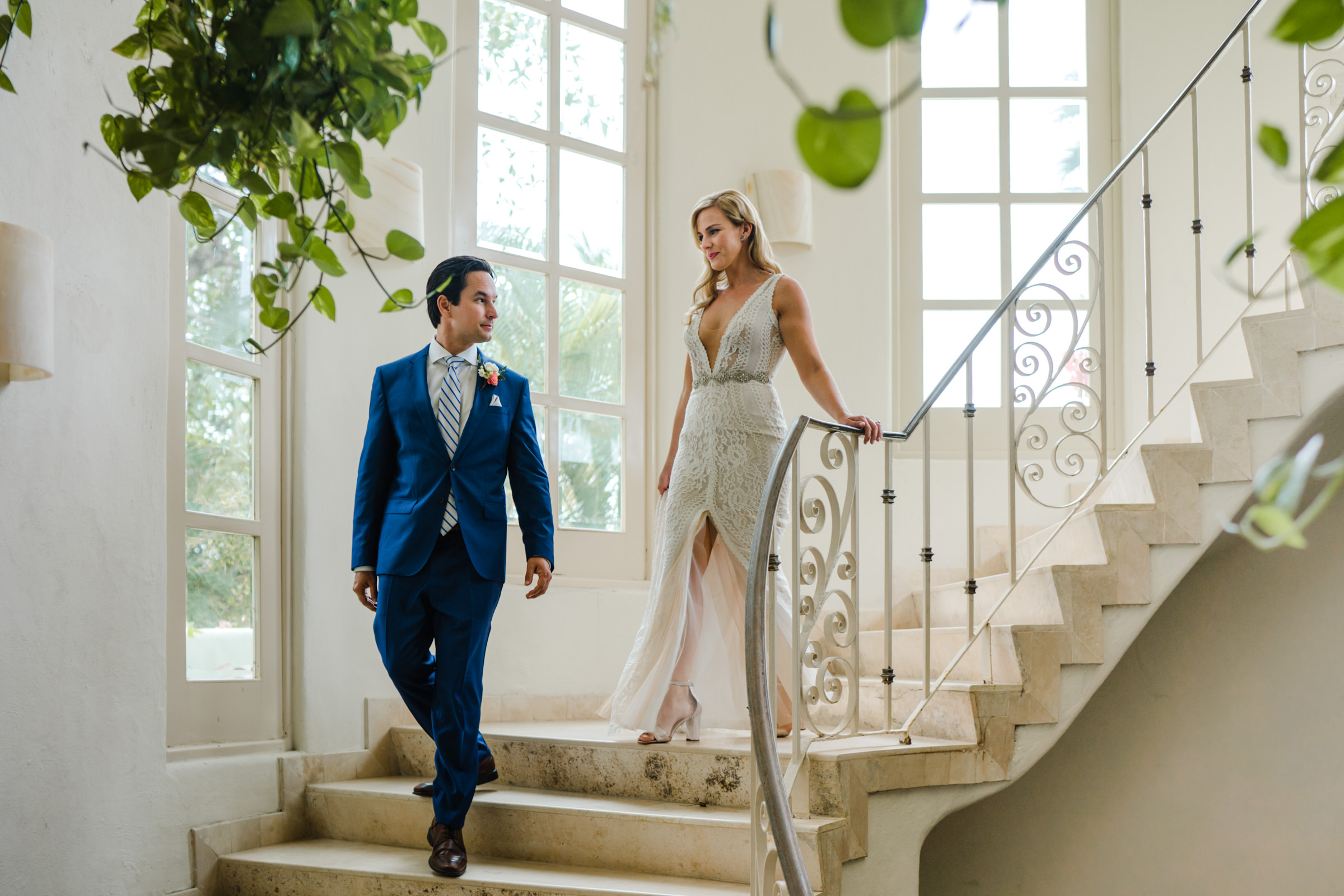 Bride and groom descending stairs - photo by Sasha Reiko Photography