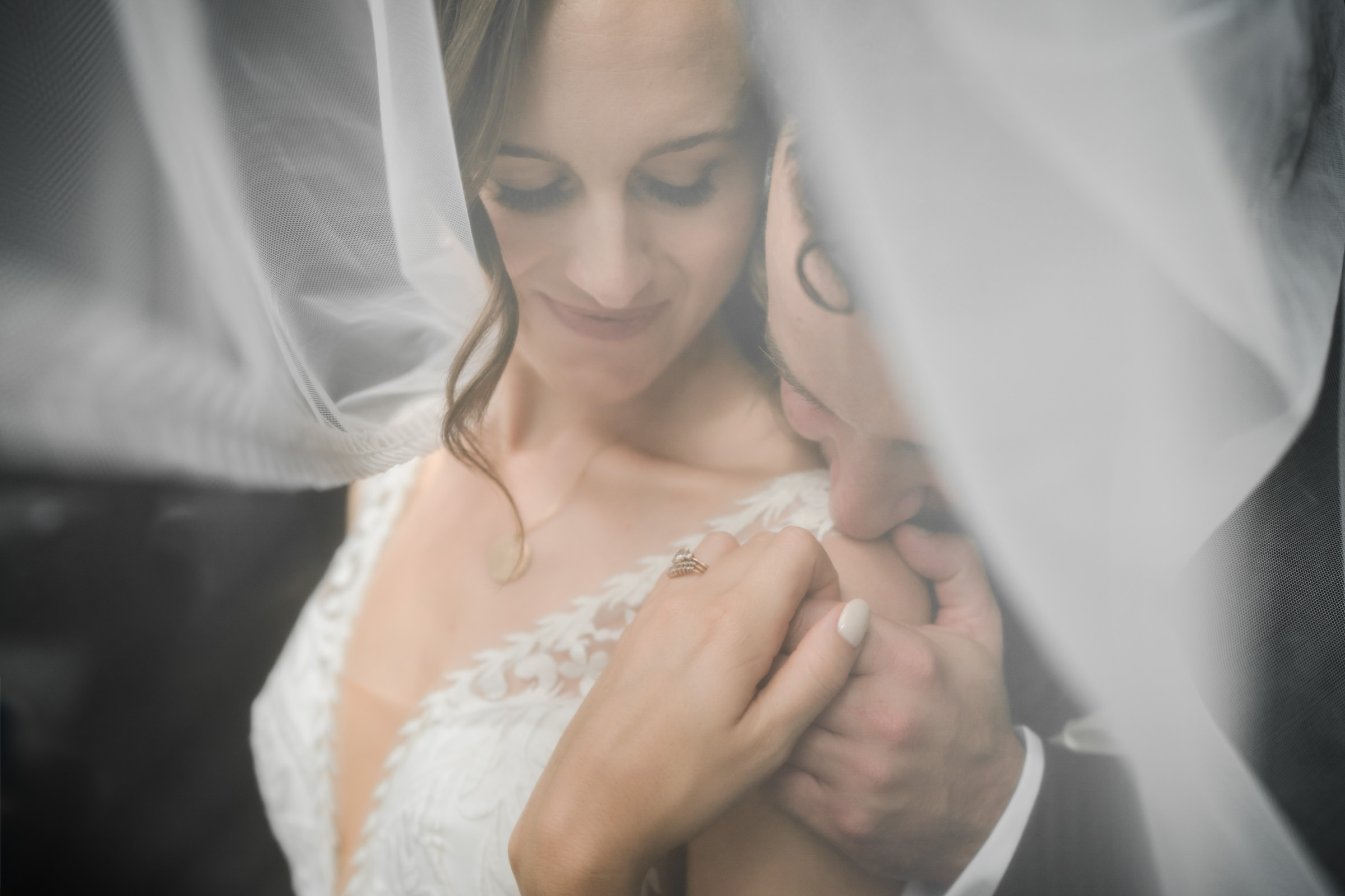 Bride and groom under veil - photo by Sasha Reiko Photography