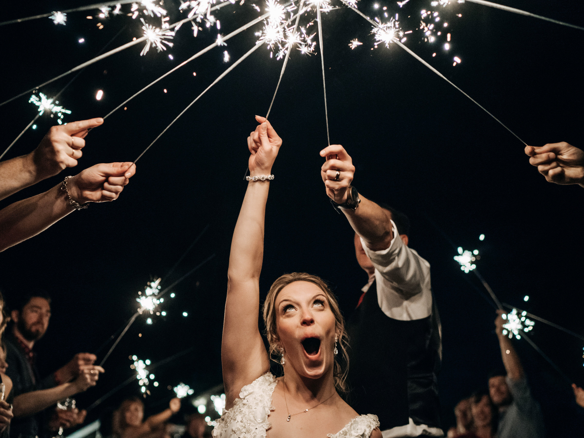 Bride makes funny face during sparklers - photo by Sasha Reiko Photography