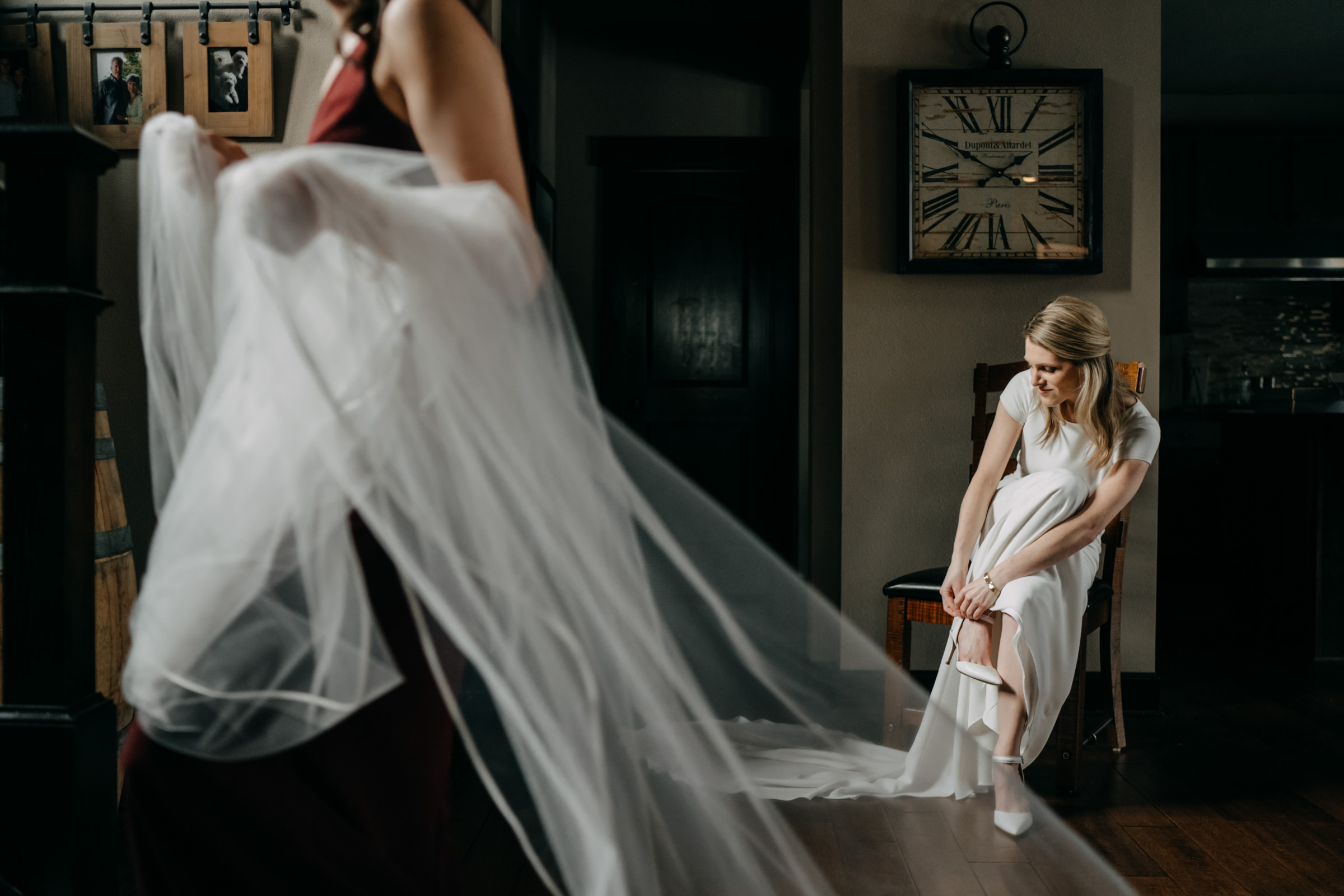 Bride putting on shoes - photo by Sasha Reiko Photography