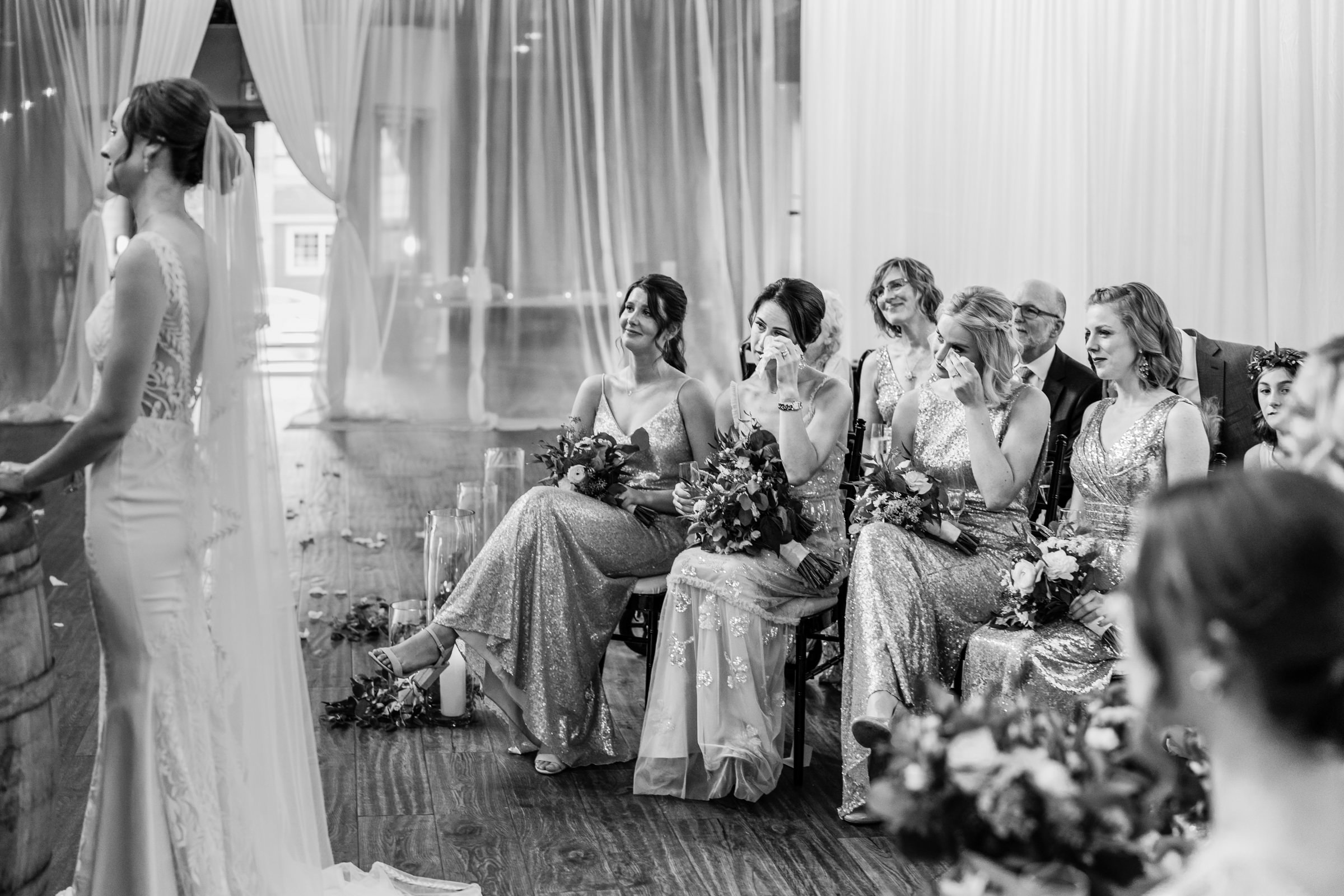 Bridesmaids tear up during ceremony - photo by Sasha Reiko Photography