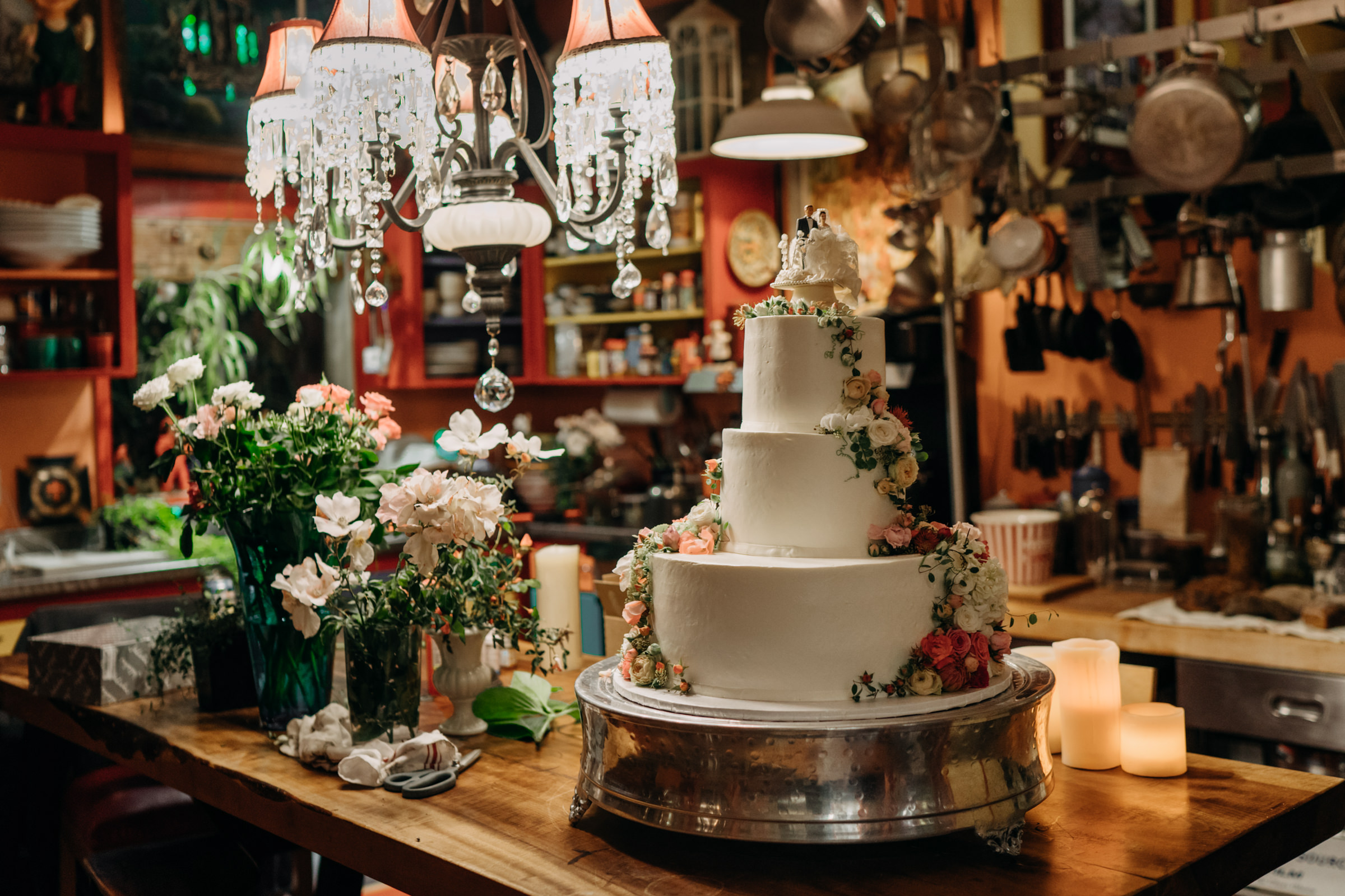 Colorful wedding cake in kitchen - photo by Sasha Reiko Photography
