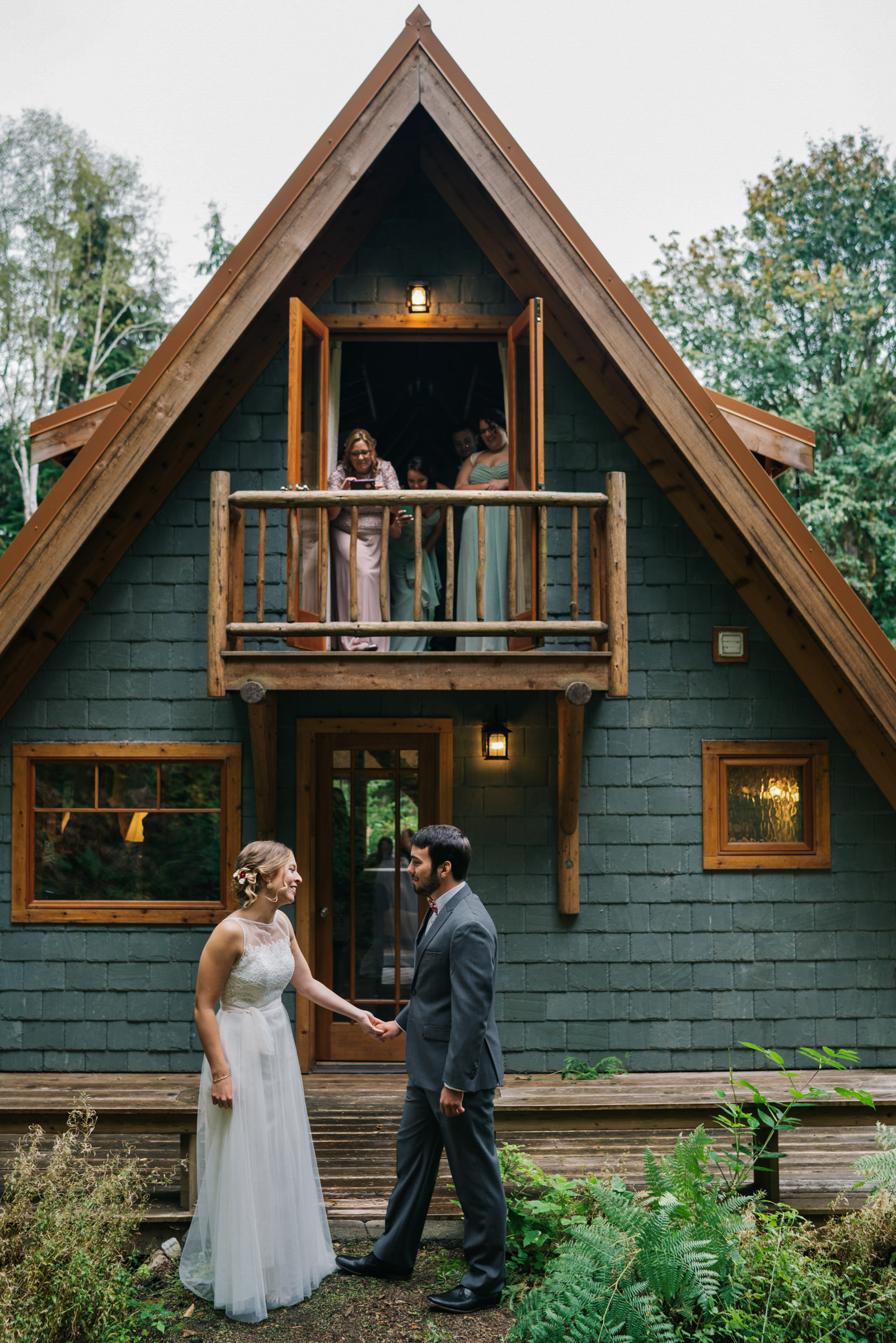 Couple at rustic cabin w bridesmaids - photo by Sasha Reiko Photography