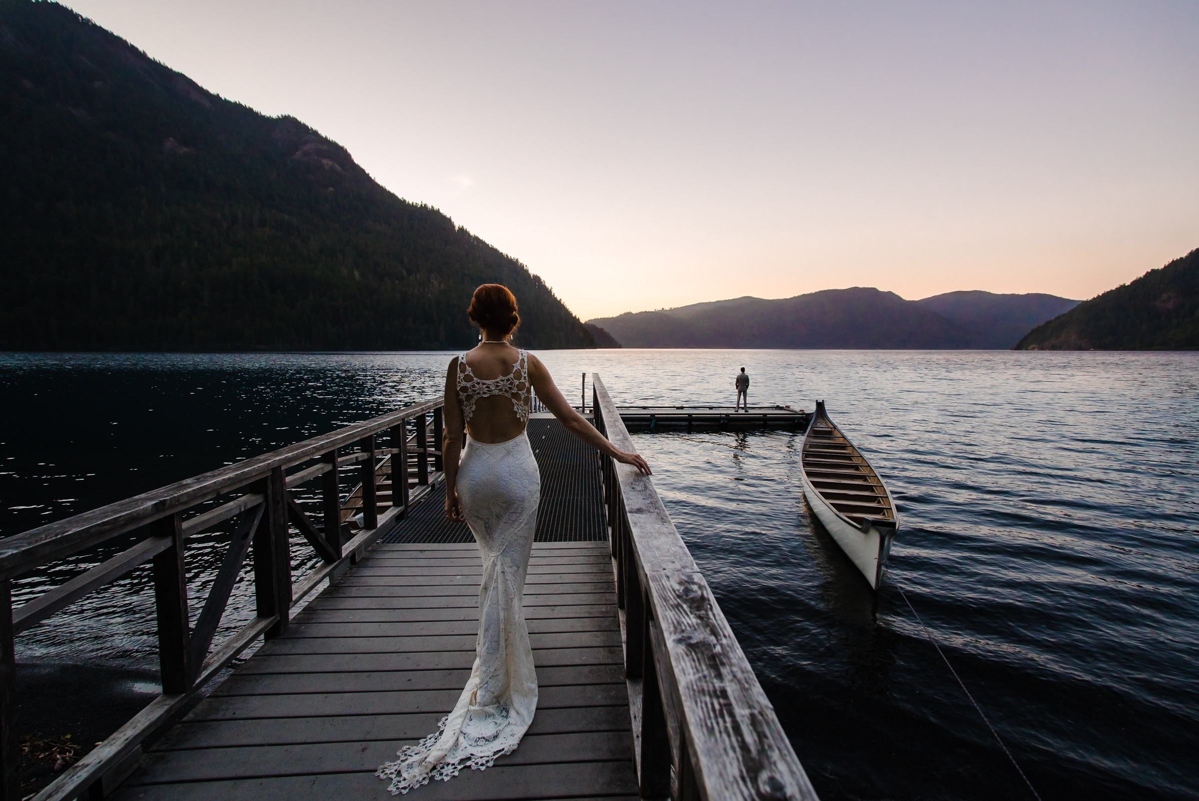 Creative composition bride on dock with groom in distance - photo by Sasha Reiko Photography