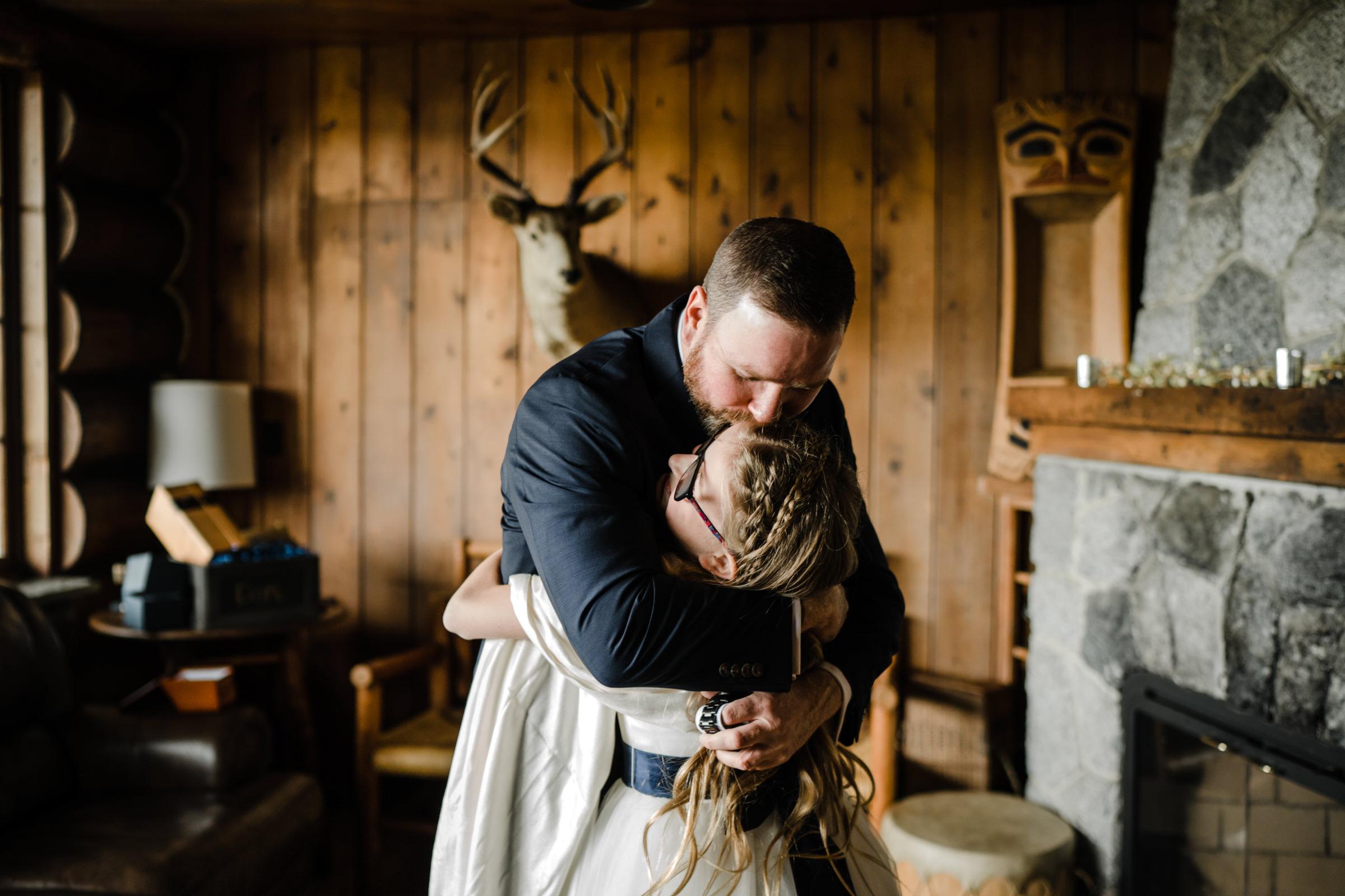 Dad and daughter share an emotional hug - photo by Sasha Reiko Photography