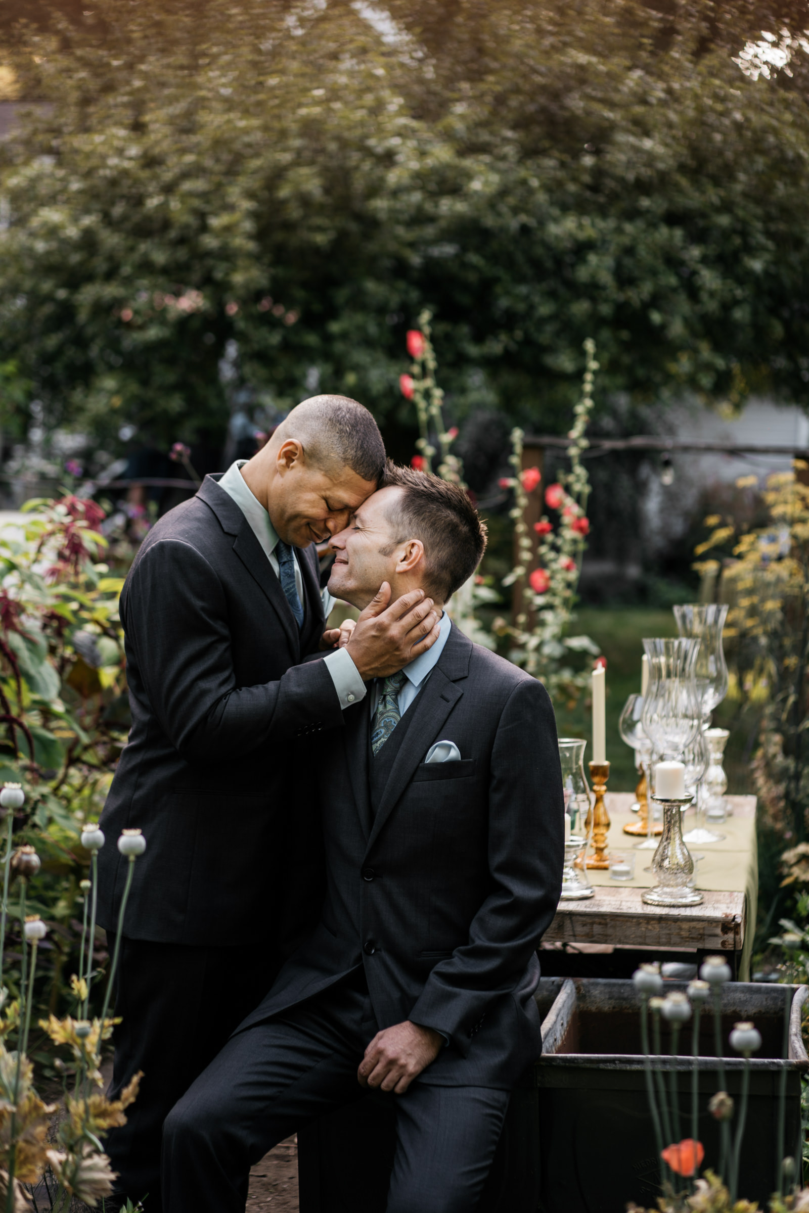 Grooms sharing a moment - photo by Sasha Reiko Photography