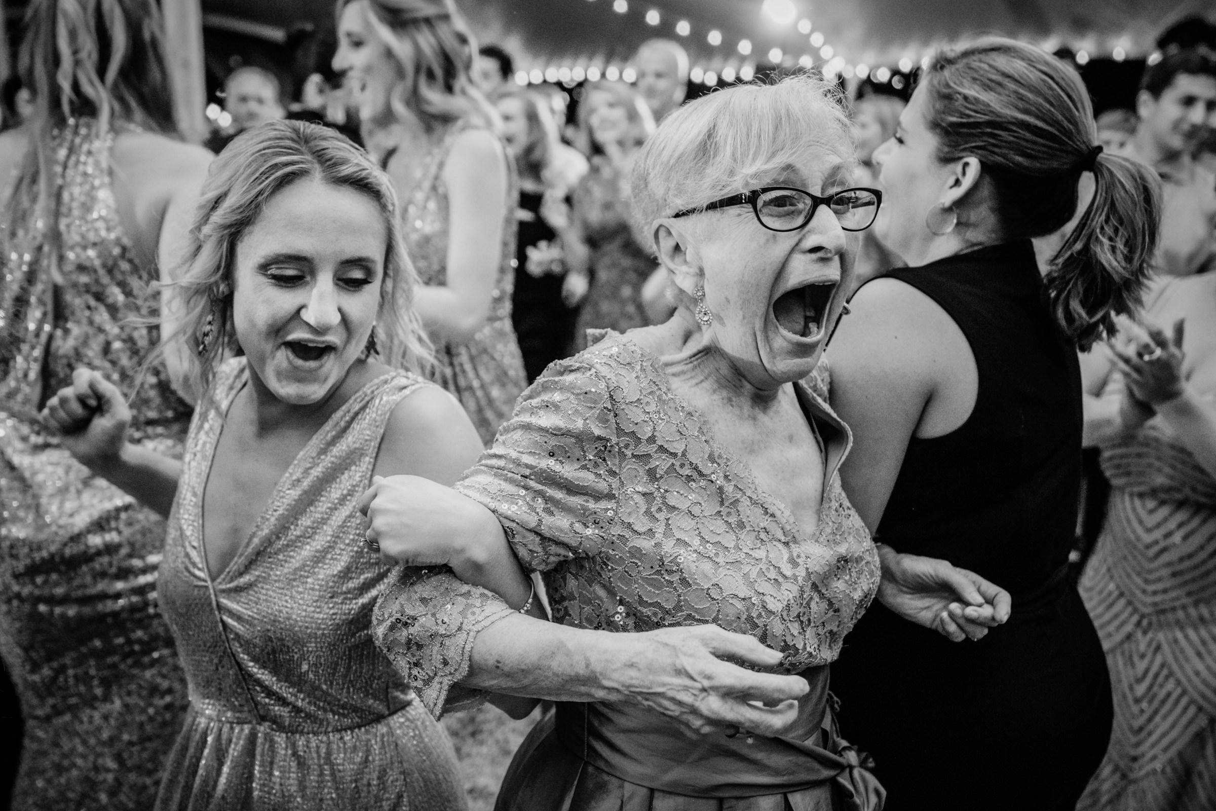 Mom and bridesmaid dancing with others - photo by Sasha Reiko Photography
