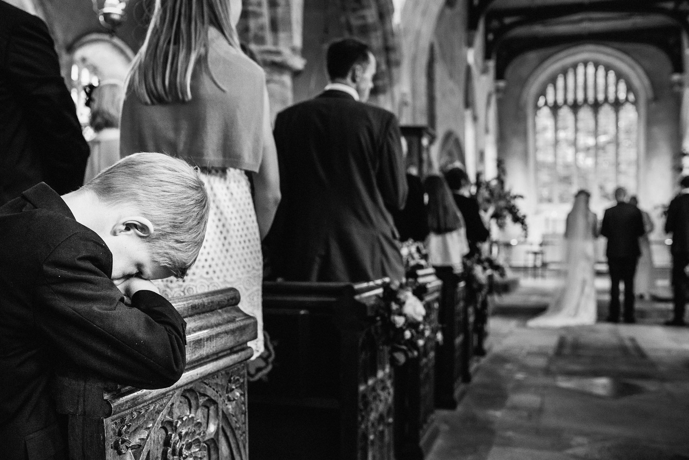 Bored little guest at ceremony photo by Andy Gaines Photography