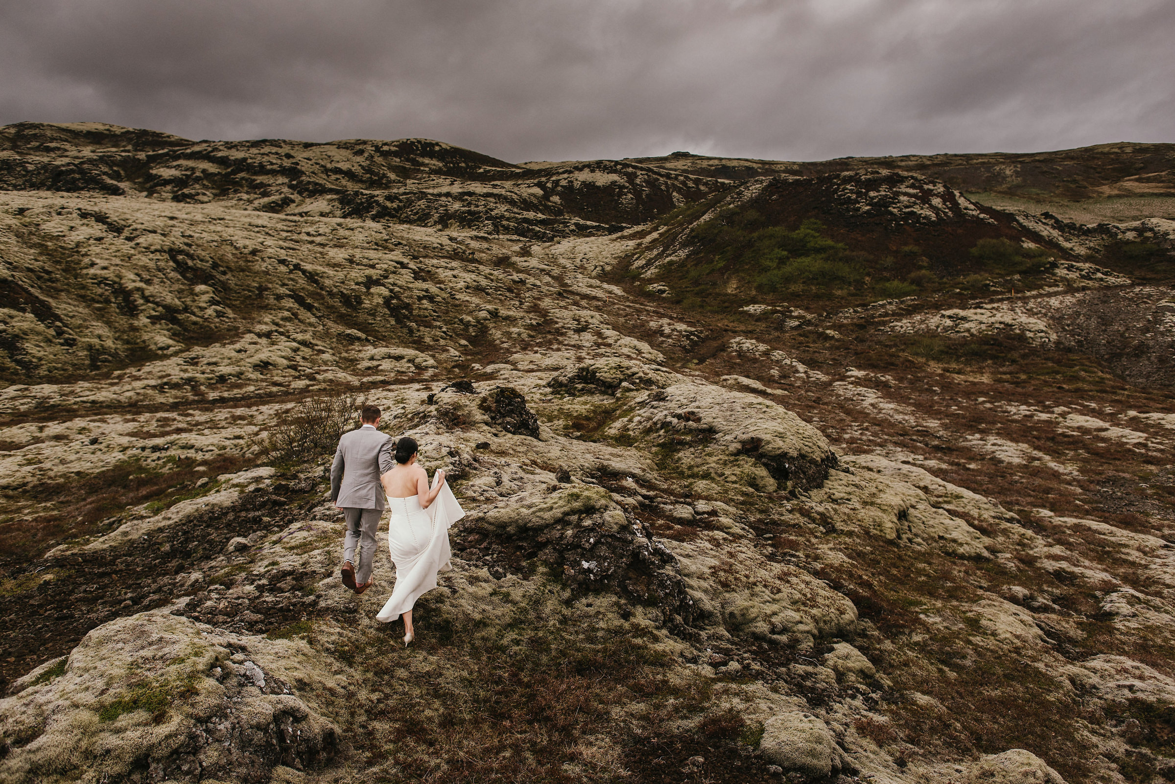 Bride and groom in rocky landscape photo by Andy Gaines Photography