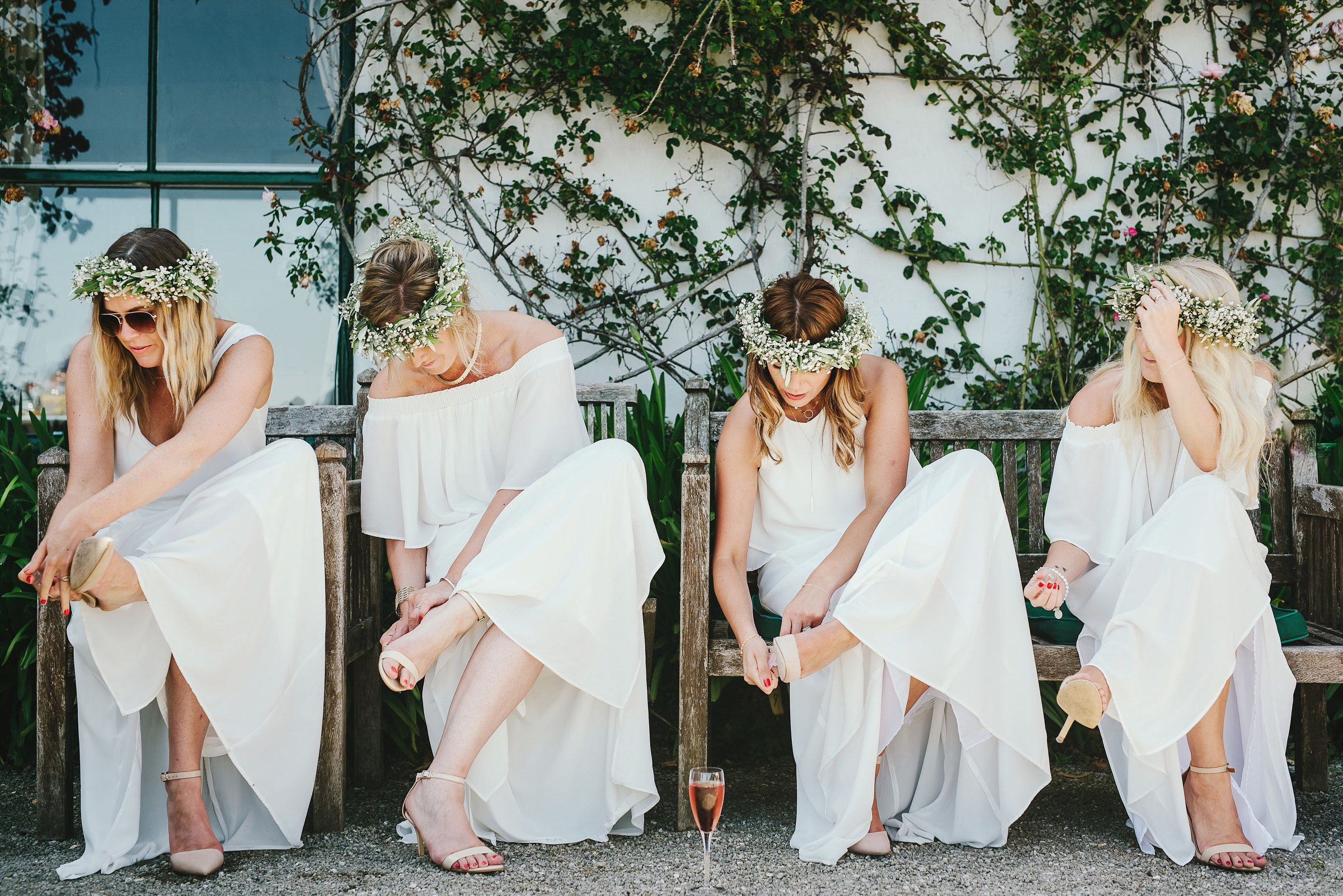 Bridesmaids putting shoes on photo by Andy Gaines Photography
