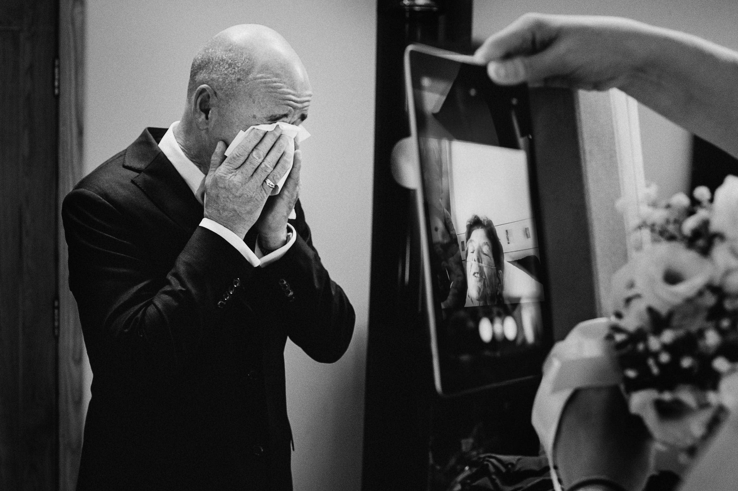 Groom tears up facetime with family photo by Andy Gaines Photography