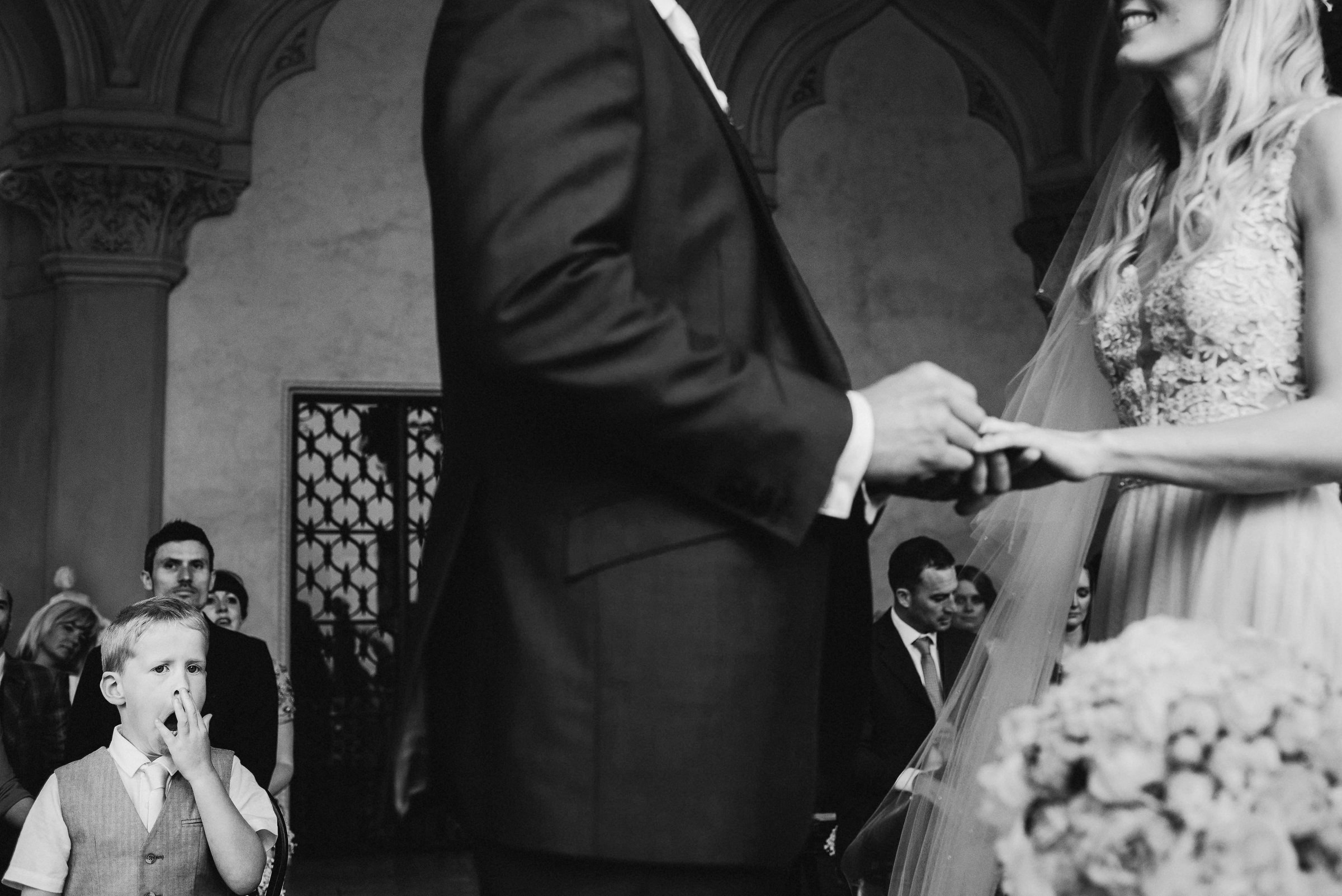 Little guest yawns during wedding ceremony photo by Andy Gaines Photography