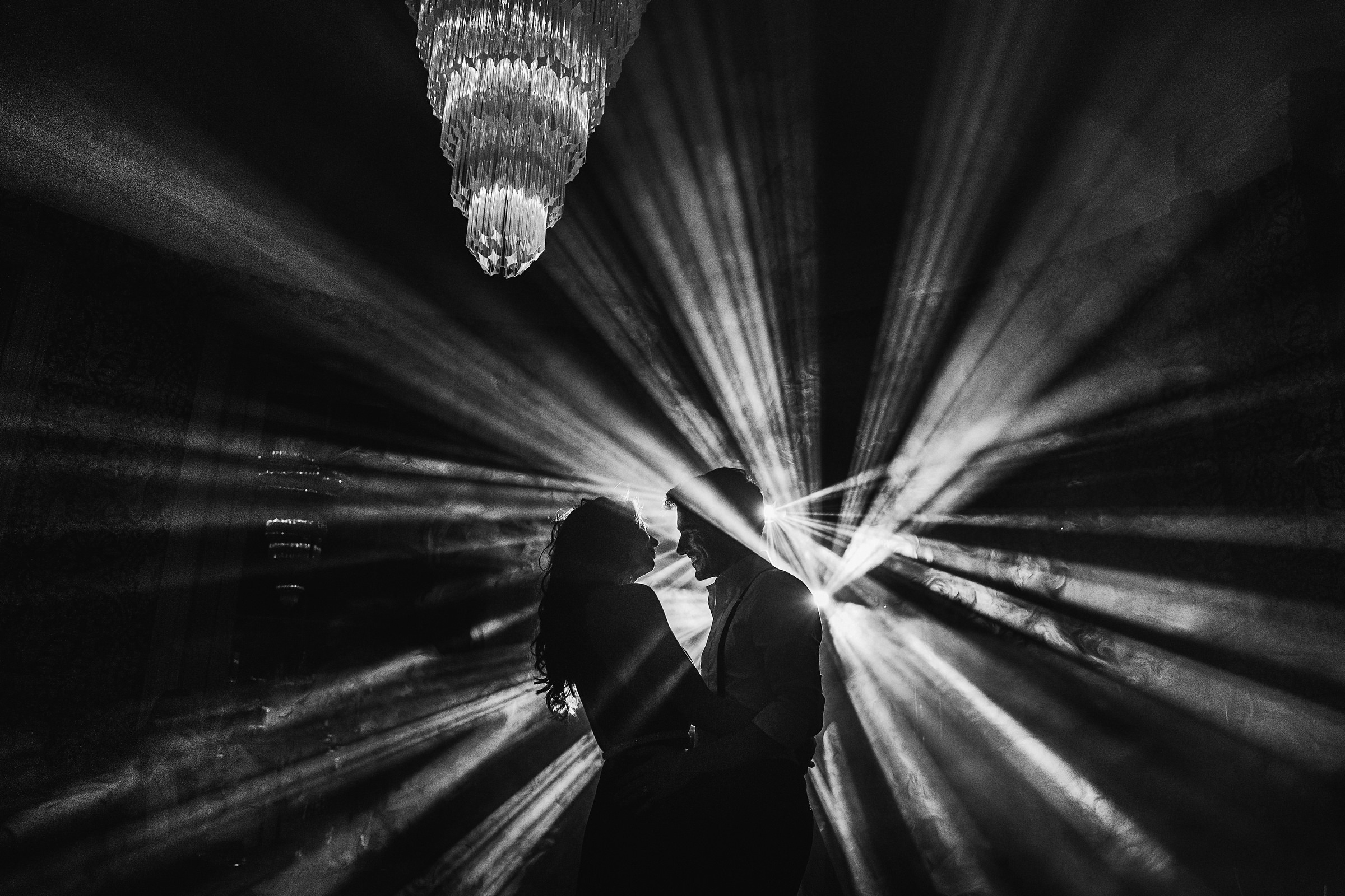 Silhouette of couple in dramatic reception lighting photo by Andy Gaines Photography