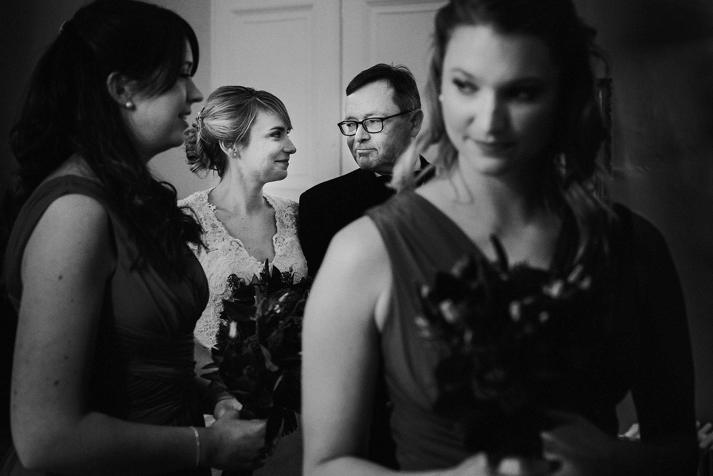 Bride and father sharing a moment amidst other guests - photo by Andy Gaines Photography