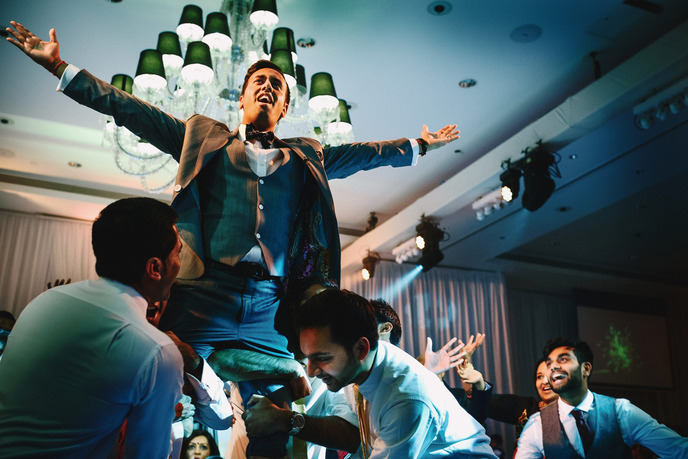 Groom held aloft - photo by Andy Gaines Photography