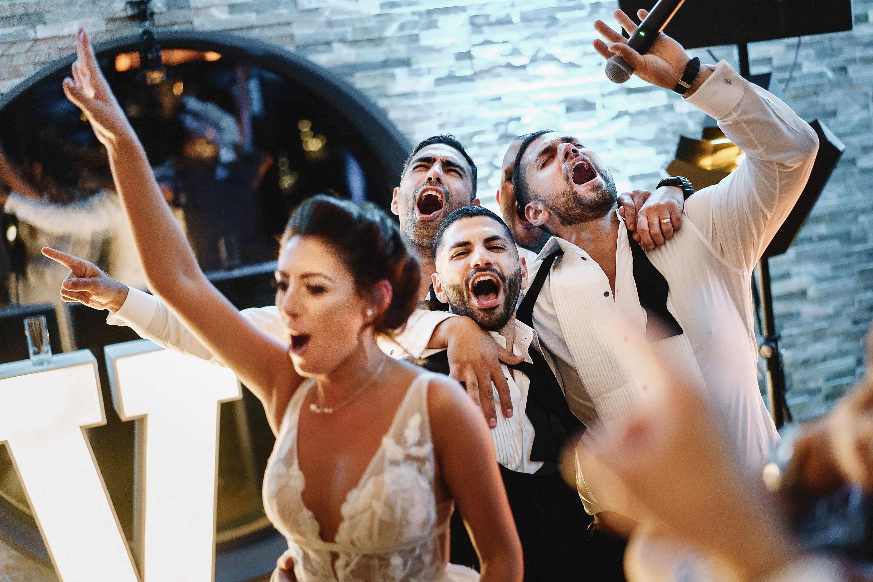 Party singing - photo by Andy Gaines Photography