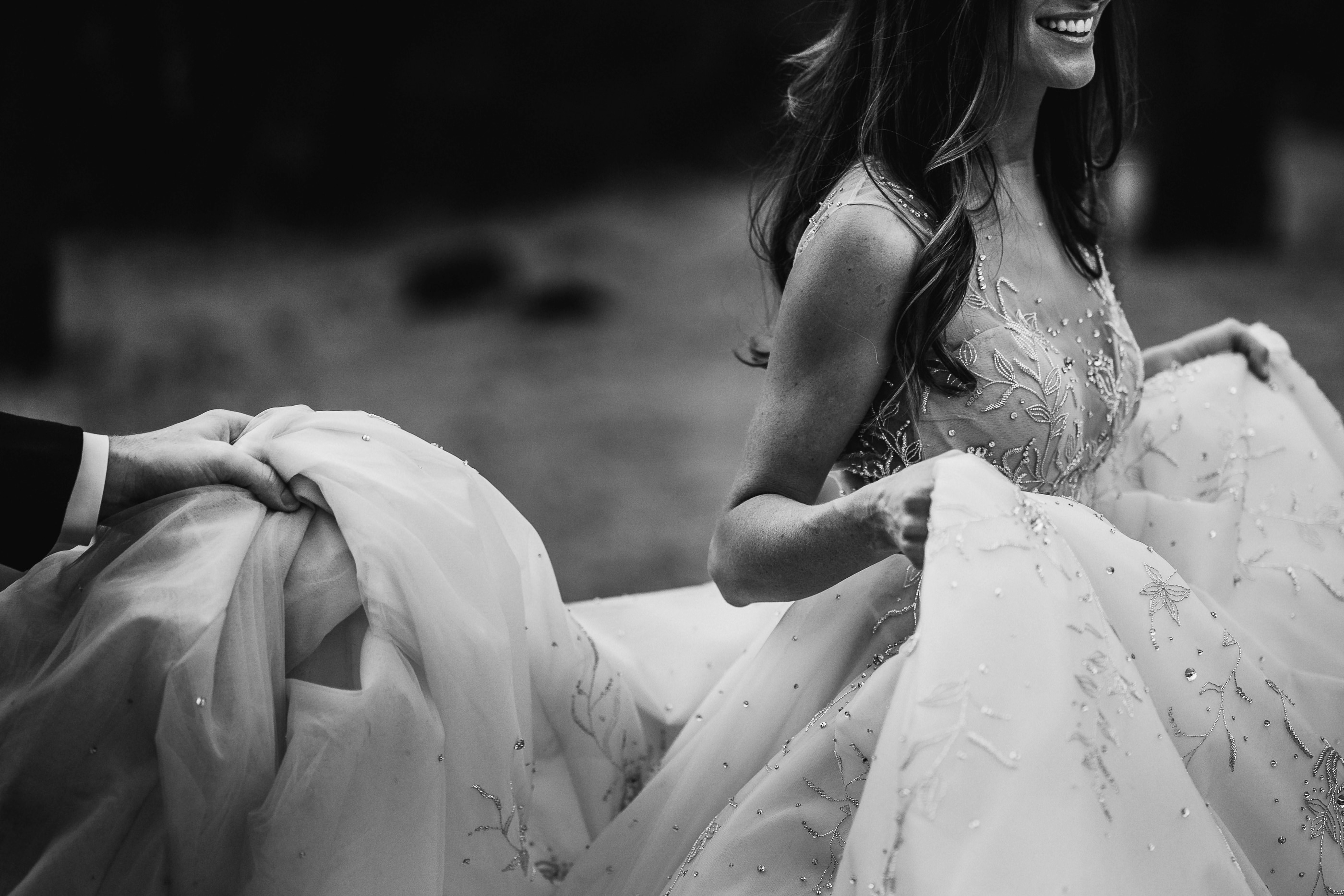 Smiling bride in voluminous gown - photo by Andy Gaines Photography