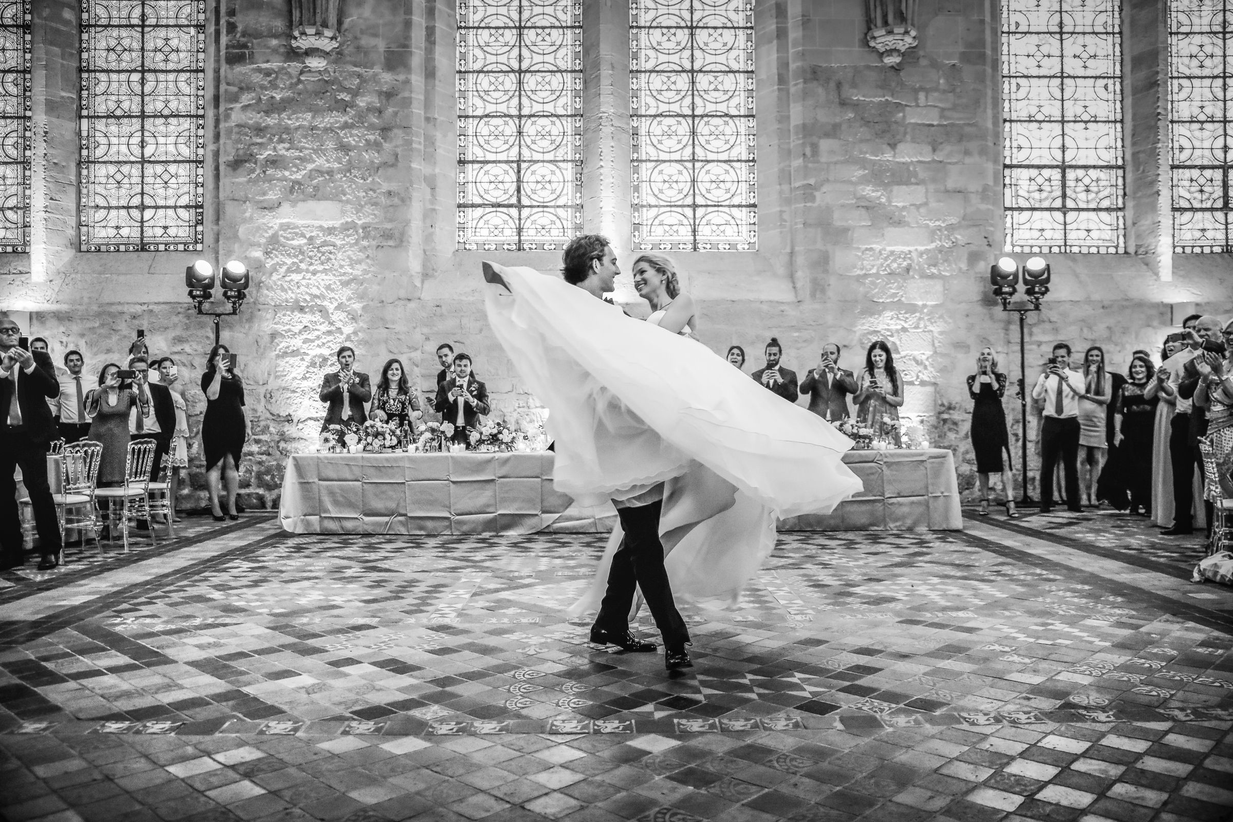 Bride twirled on tiled dance floor by groom - photo by Julien Laurent-Georges