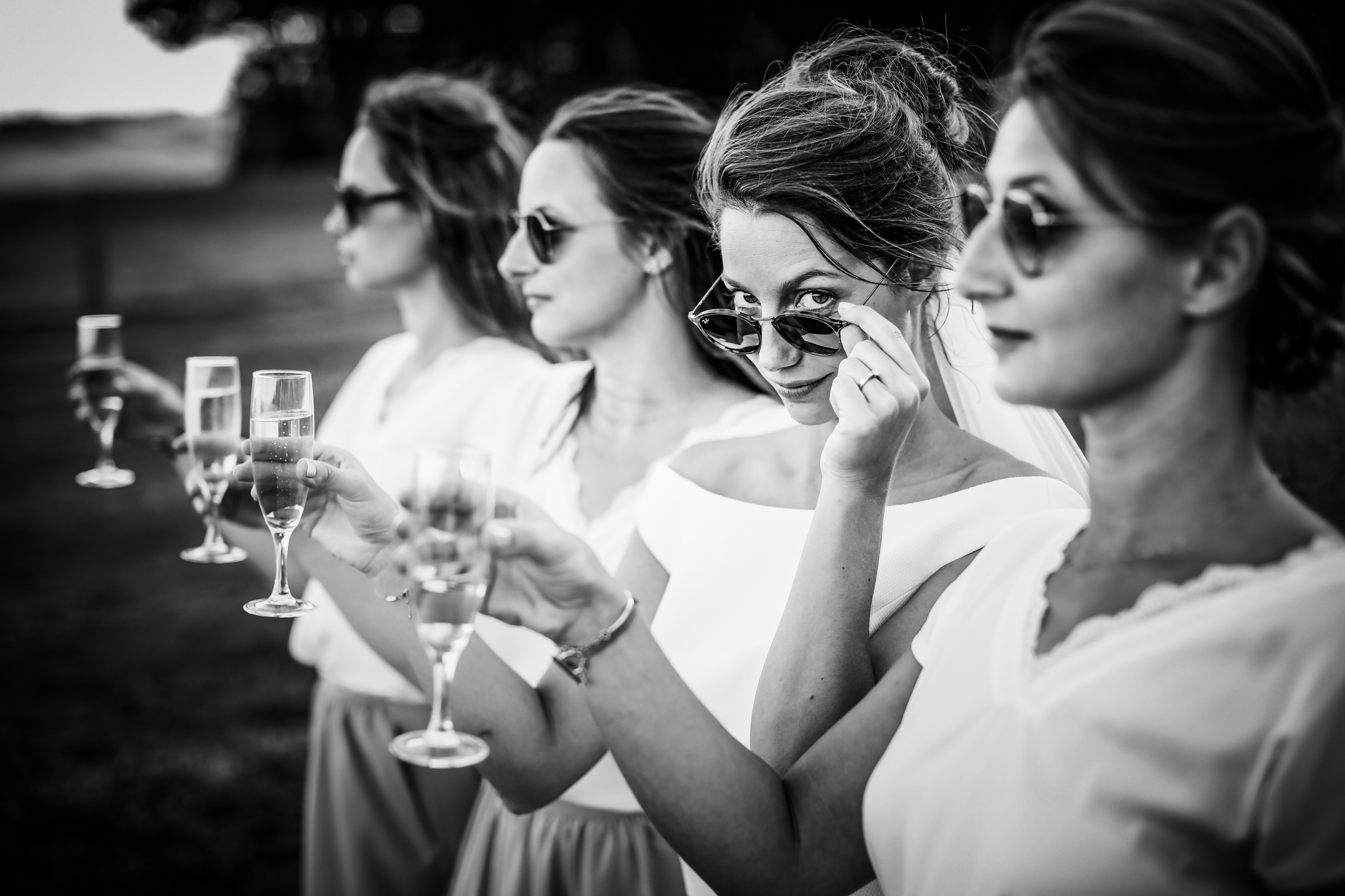Bridemaids toasting - photo by Julien Laurent-Georges